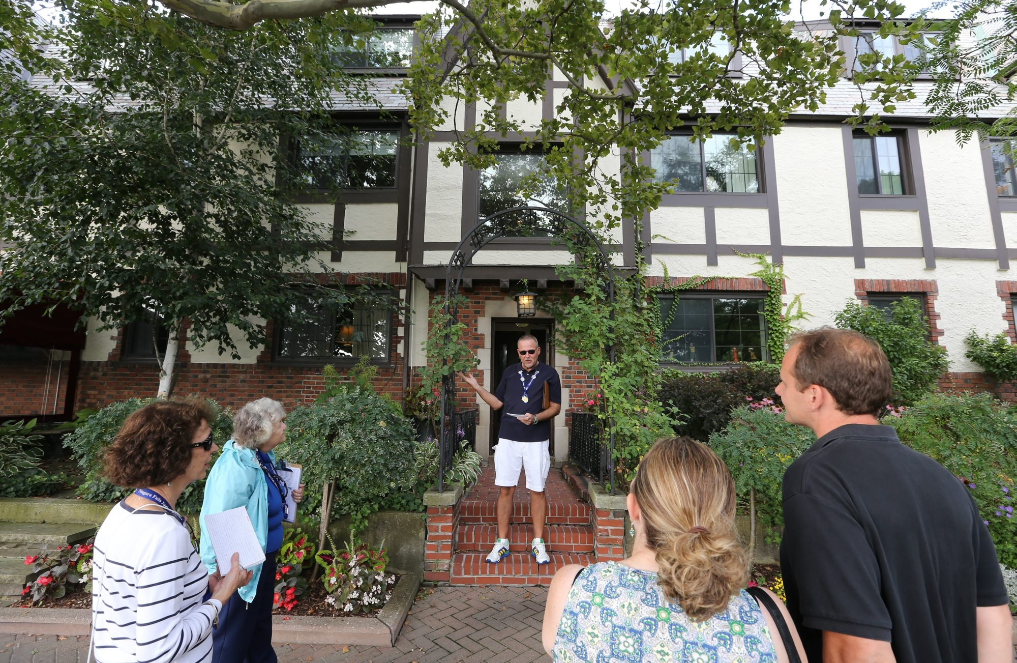 Tour guide Tom Batt, a member of the staff of certified docents trained by Preservation Buffalo Niagara, explains the Red Coach Inn's role in Niagara Falls over the years to a group taking the new walking tour that focuses on culture, history and architecture.