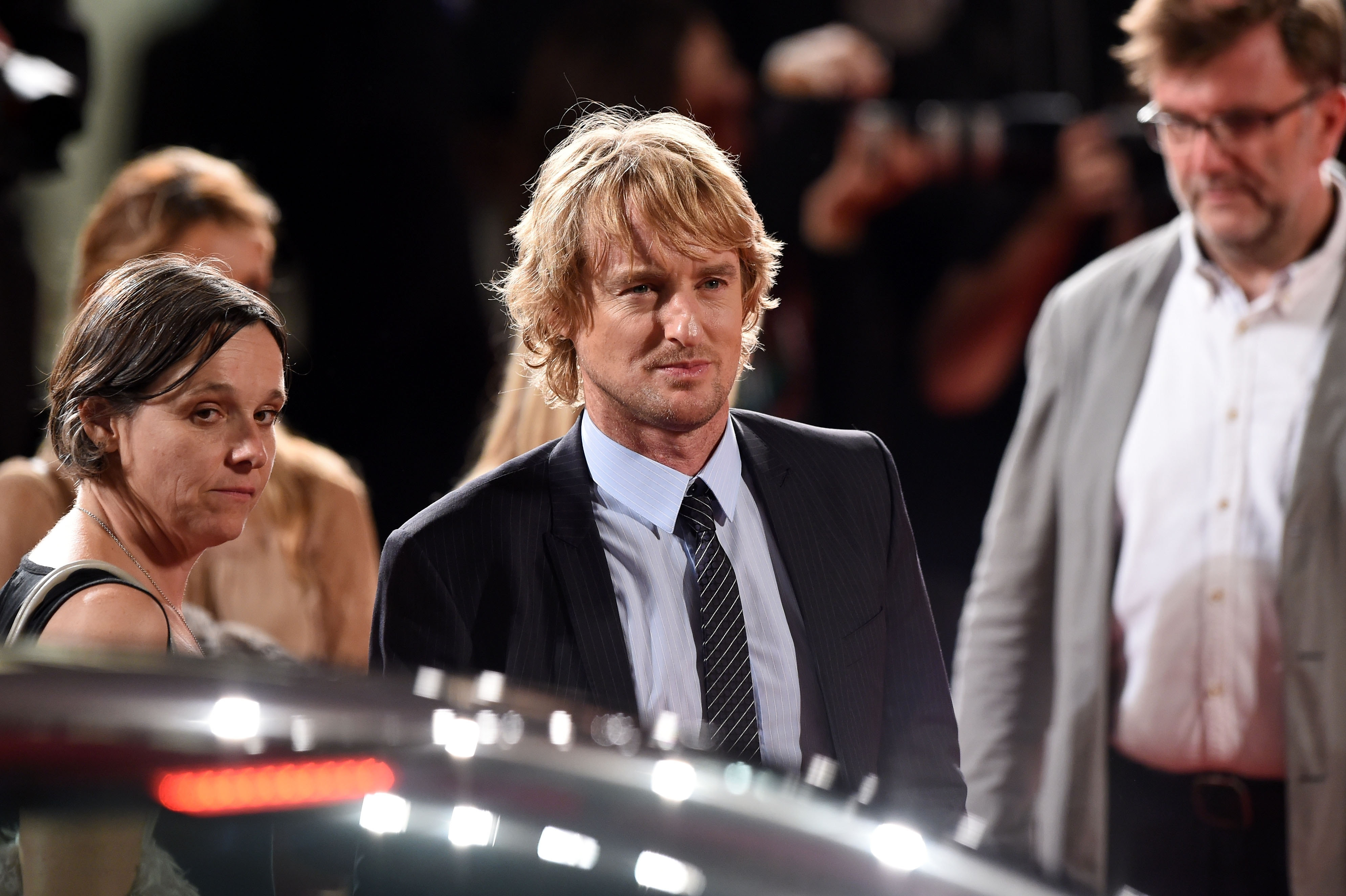 "Drifting through:  Actor Owen Wilson attends the premiere of ""She's Funny That Way"" Thursday in Italy during the 71st Venice Film Festival."