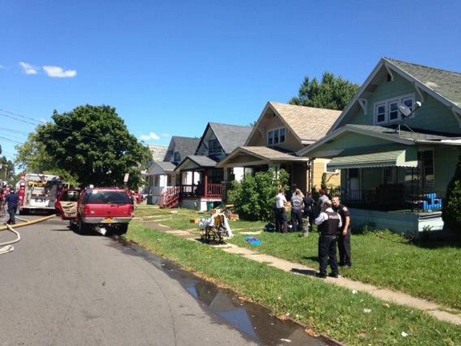 Emergency personnel at the scene of today's fire on Sprenger Avenue. (John Hickey/Buffalo News)