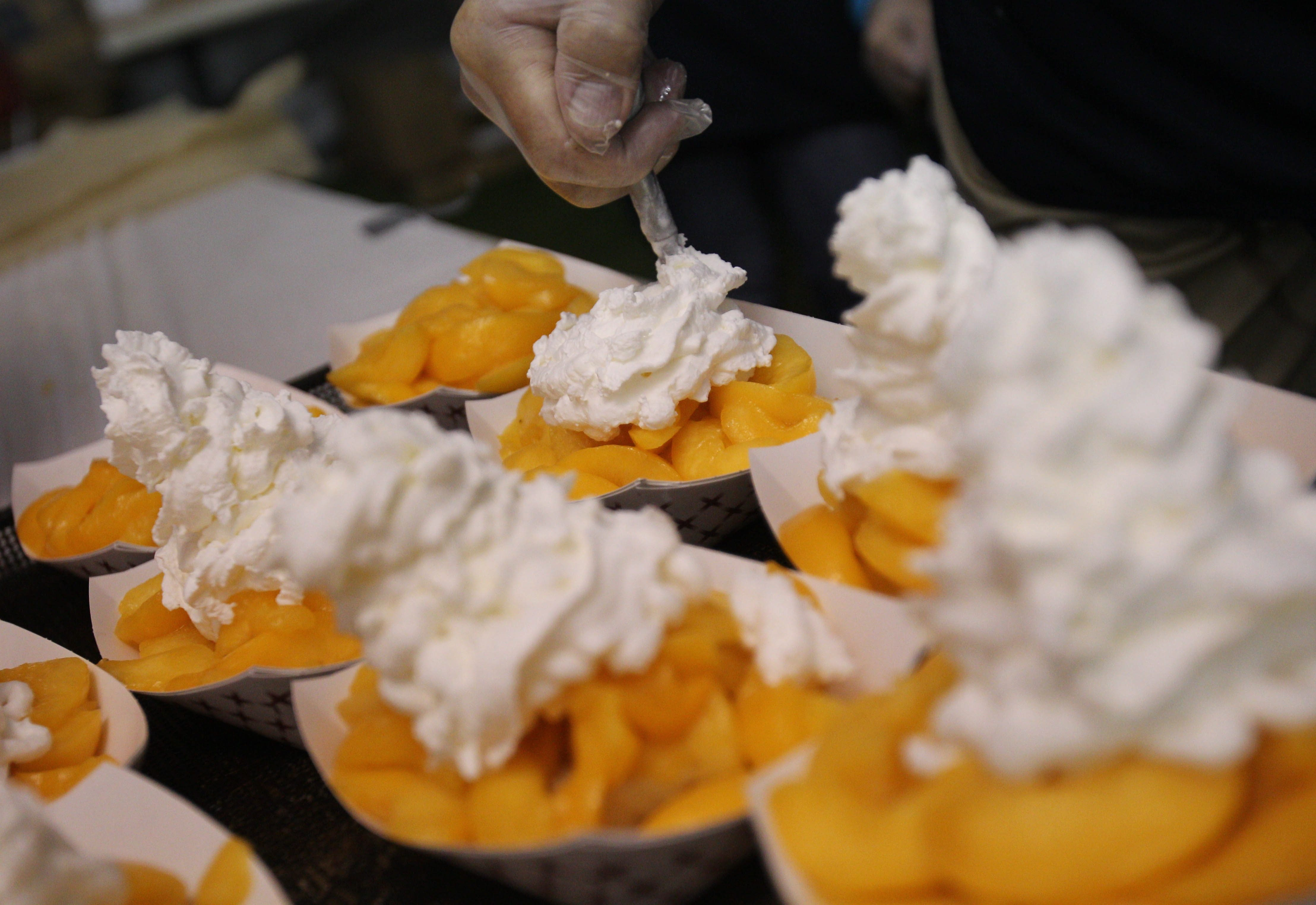 There always is plenty of whipped cream on the peach cobblers at the Lewiston Kiwanis Peach Festival, running Friday through next Sunday.