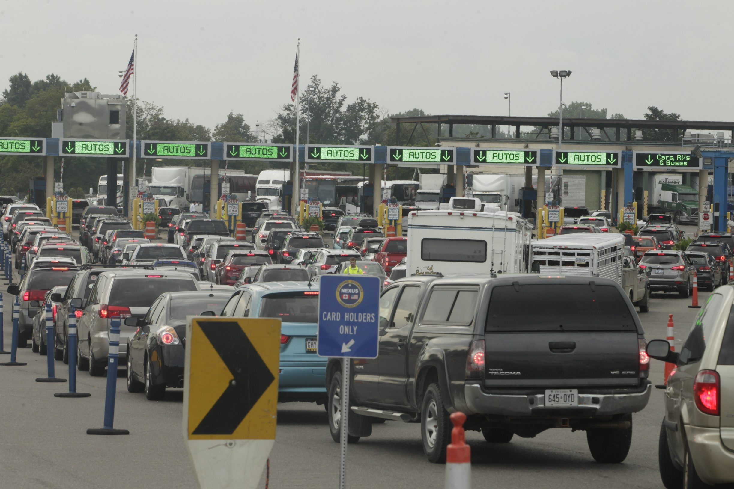 Vehicles idle while waiting to enter the United States from Canada via the Peace Bridge on Friday. Inadequate staffing at inspection booths or longer processing times are causing most of the recent traffic at area crossings, officials on both sides of the border say.