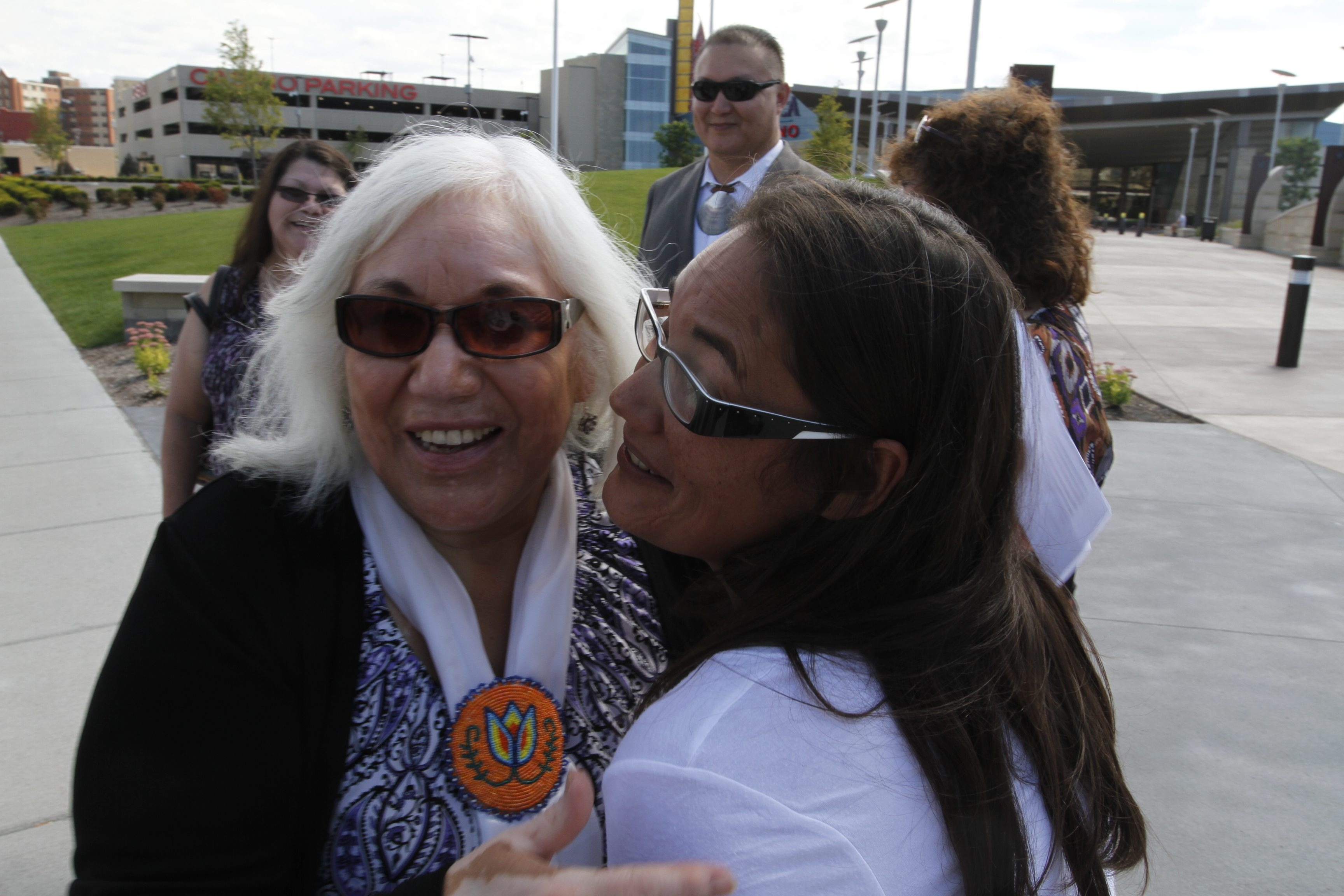 Darlene Miller, left, receives a hug from her daughter Luane Miller outside Seneca Buffalo Creek Casino after announcing her candidacy to become the first female president of the Seneca Nation.