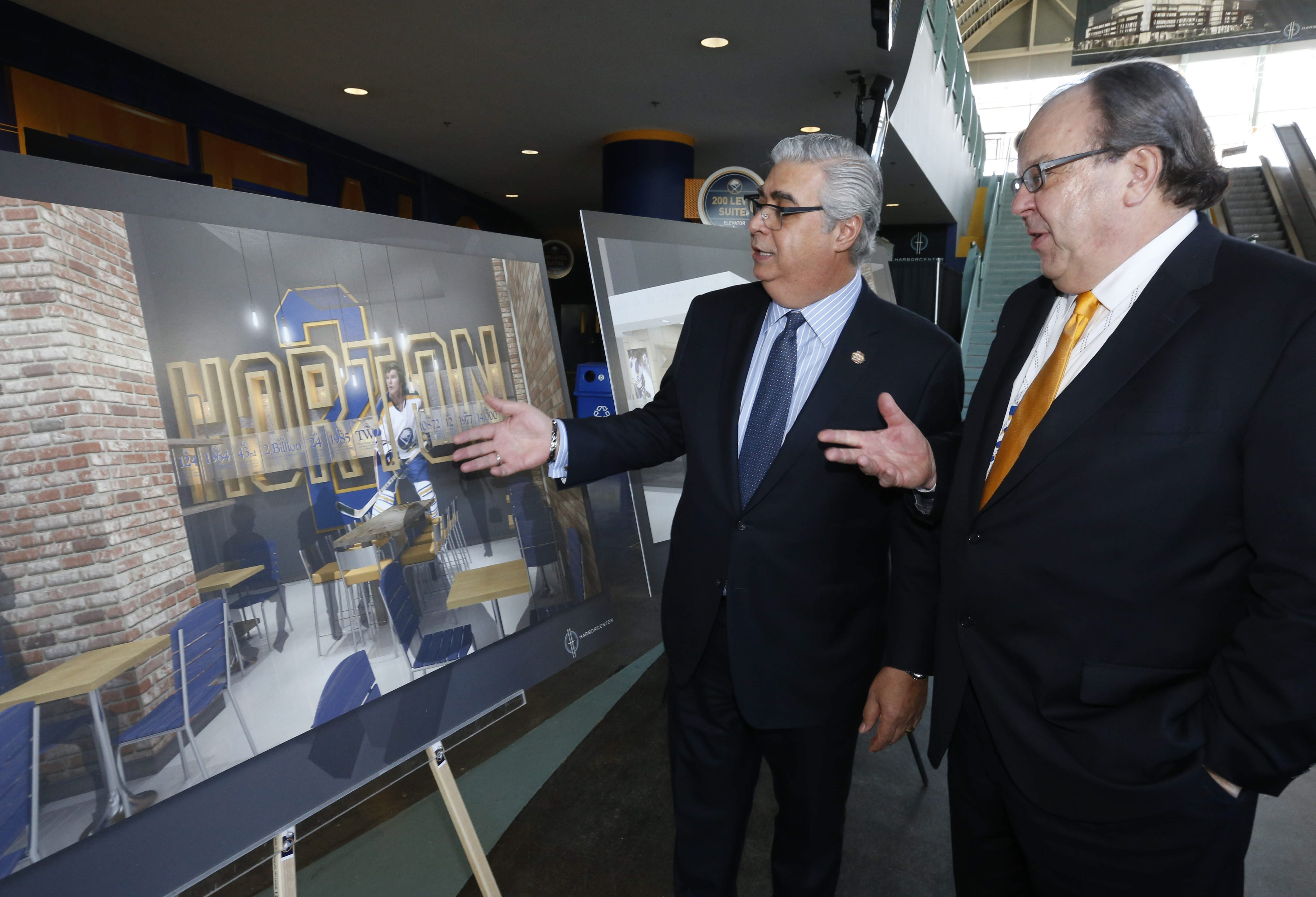 "Tim Hortons CEO Marc Caira, left, and HarborCenter President John Koelmel in April announced the inclusion of a ""one-of-a-kind"" Tim Hortons Cafe & Bakeshop in the new HarborCenter."