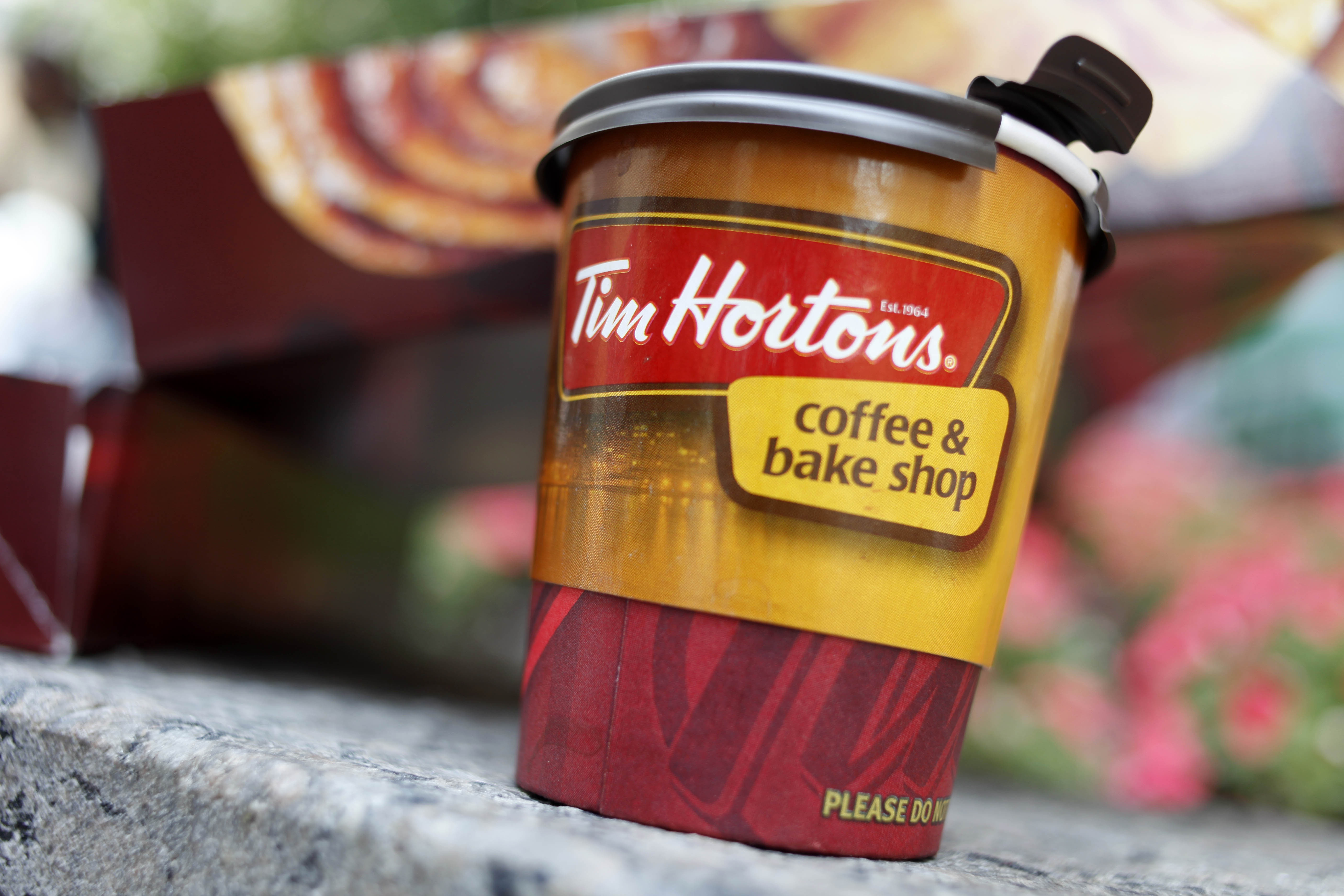 Burger King is in talks to buy the Canada-based doughnut chain Tim Hortons. If the deal goes through, Burger King corporate headquarters would move to Canada to take advantage of its lower corporate tax rate. (AP Photo/Seth Wenig, File)