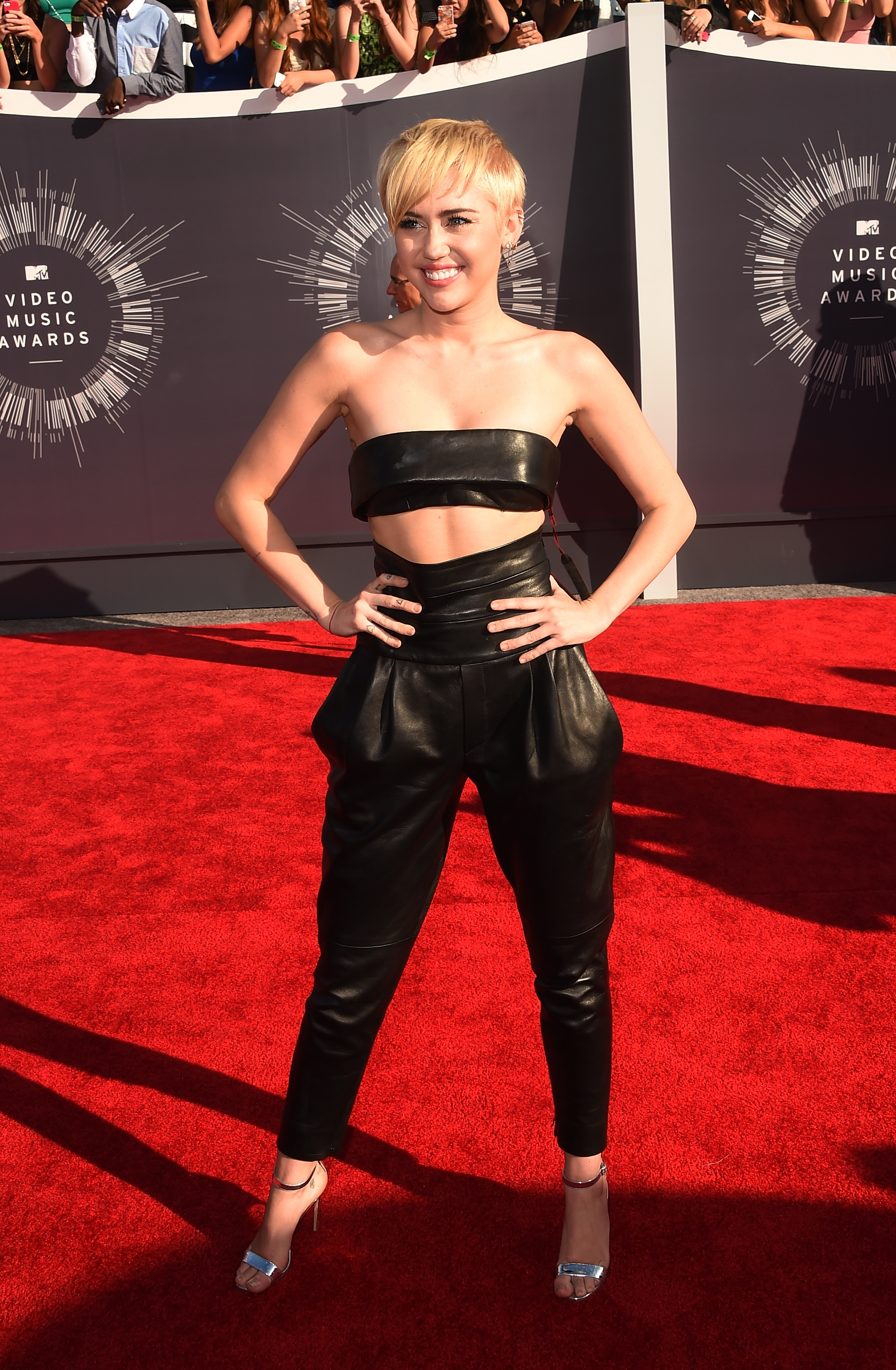 Miley Cyrus made a statement with more than her fashion Sunday night at the MTV Video Music Awards.