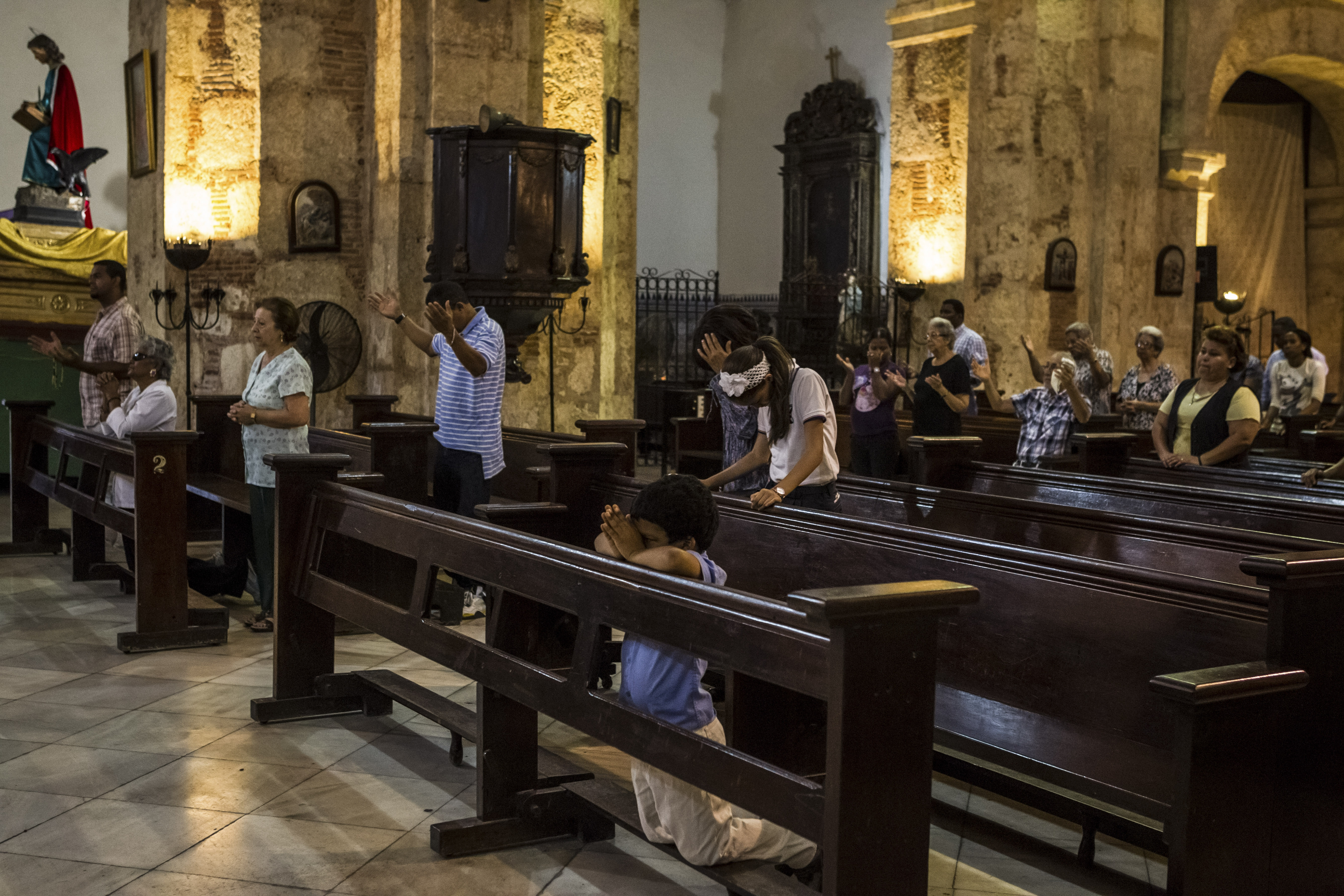Parishoners attend a service at a church in the historic district of Santo Domingo, Dominican Republic. Josef Wesolowski, the Vatican's former top ambassador to the Dominican Republic, has been defrocked after becoming the first nuncio to be accused of sexually abusing minors.