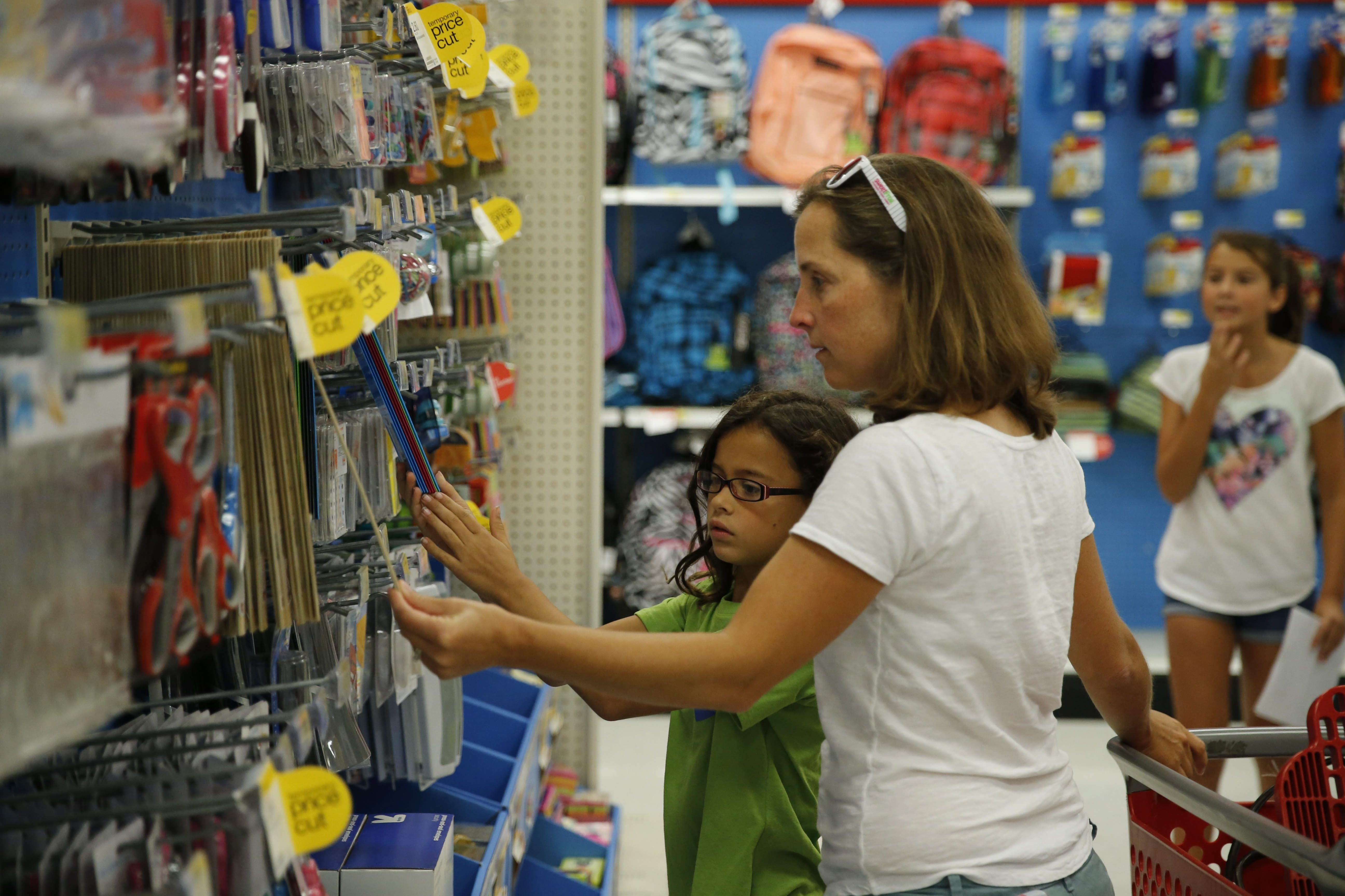 Alex Passarell, of Orchard Park, helps her daughter Charlotte, 8, pick out a ruler as they do back-to-school shopping at Target in Depew on Thursday.