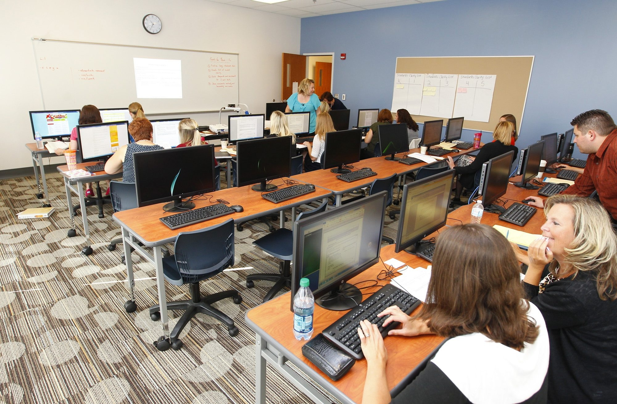 South Buffalo Charter School teachers work on professional development Thursday in a computer lab as the South Ogden Street building debuts before Monday's first day of class for 800 students.
