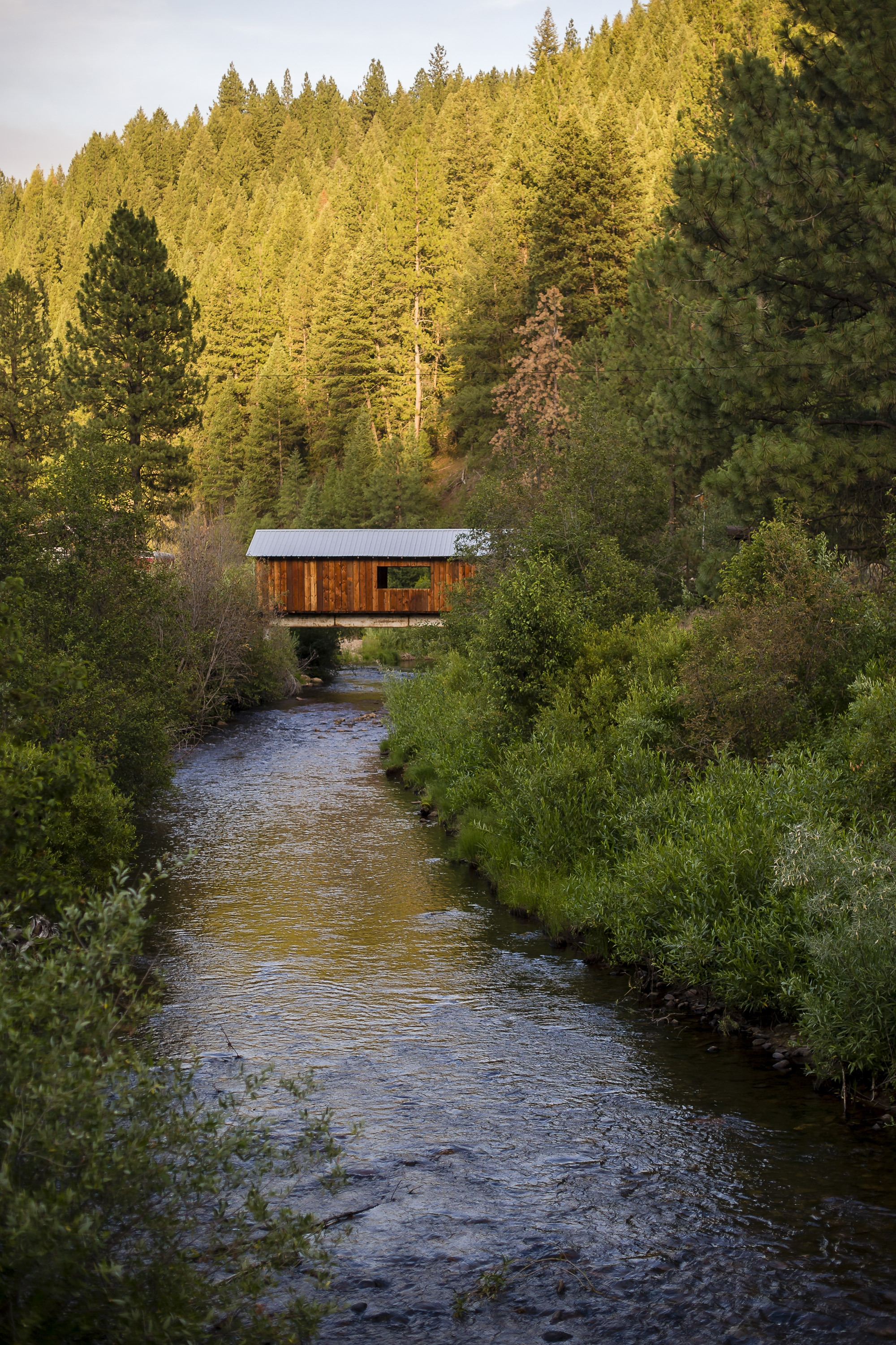 A covered bridge over one of myriad creeks and streams traversed by Idaho's Highway 21, known as the Highway to Heaven, near Idaho City, Idaho.