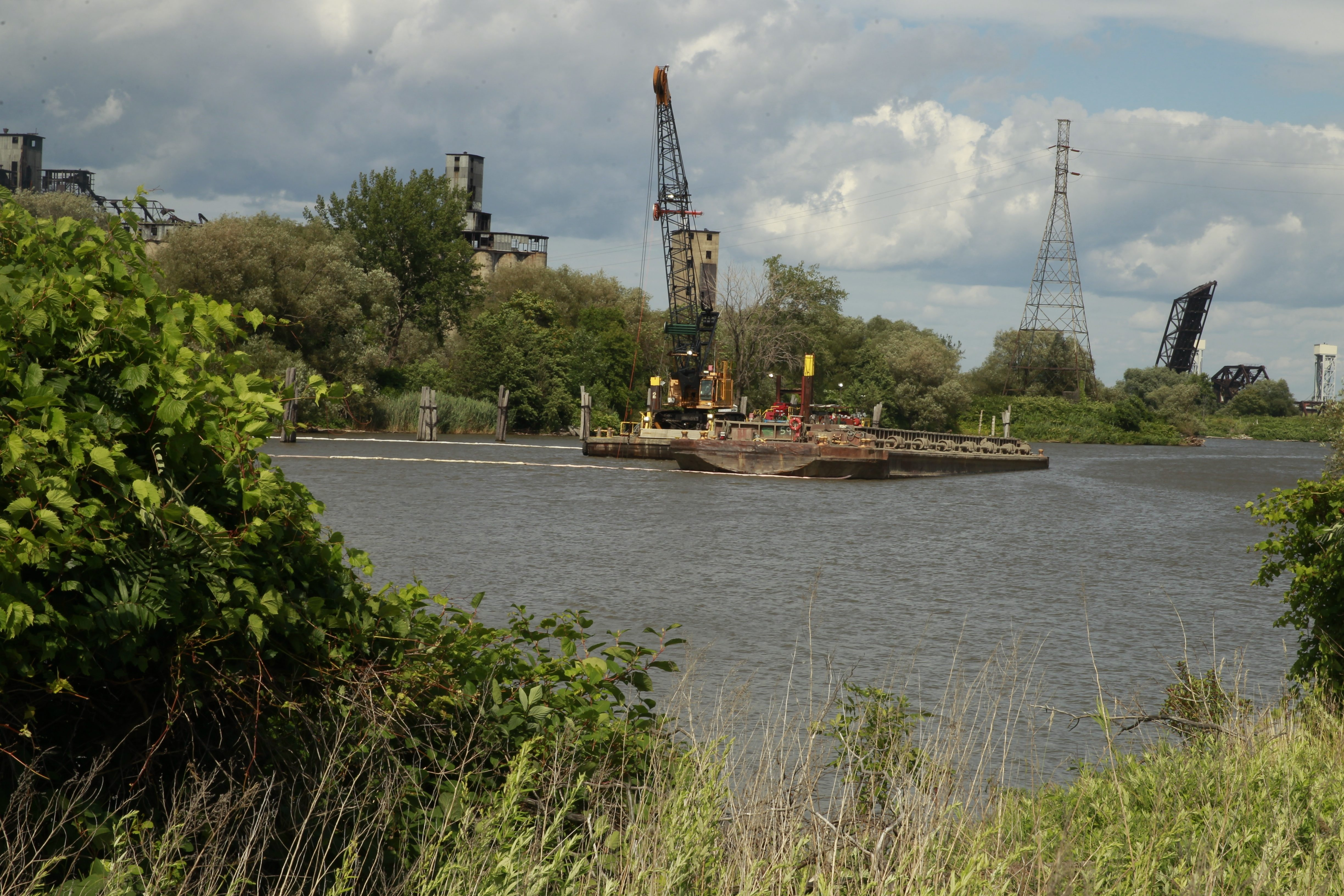 A large crane at the foot of Katherine Street is being used to dredge the Buffalo River. So far, more than 275,000 cubic yards of contaminated sludge – as well shopping carts, tires and even a vehicle or two – have been pulled from the water.