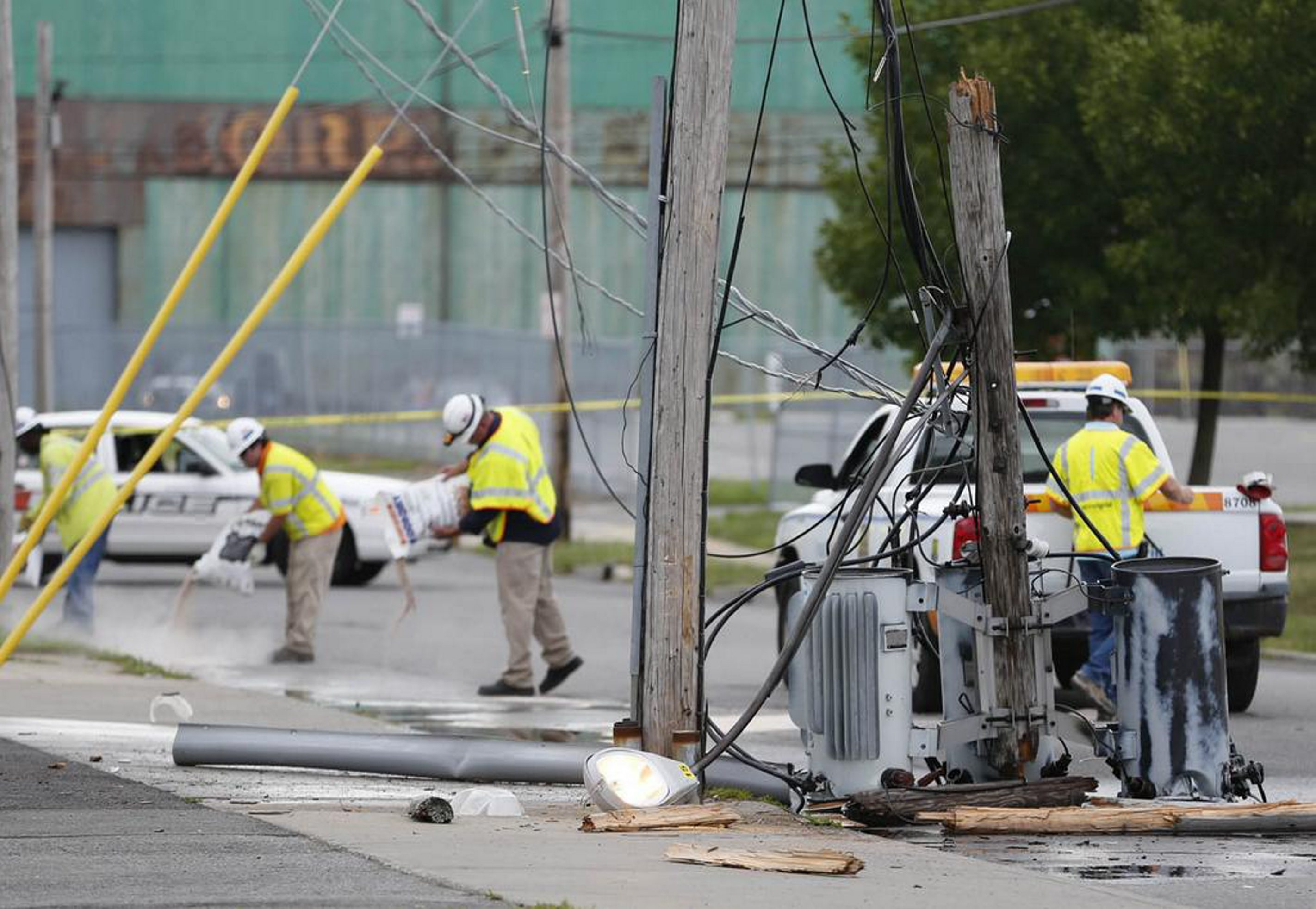 National Grid cleans up oil from a transformer bank that fell after a truck snagged a line on Letchworth near Grant.