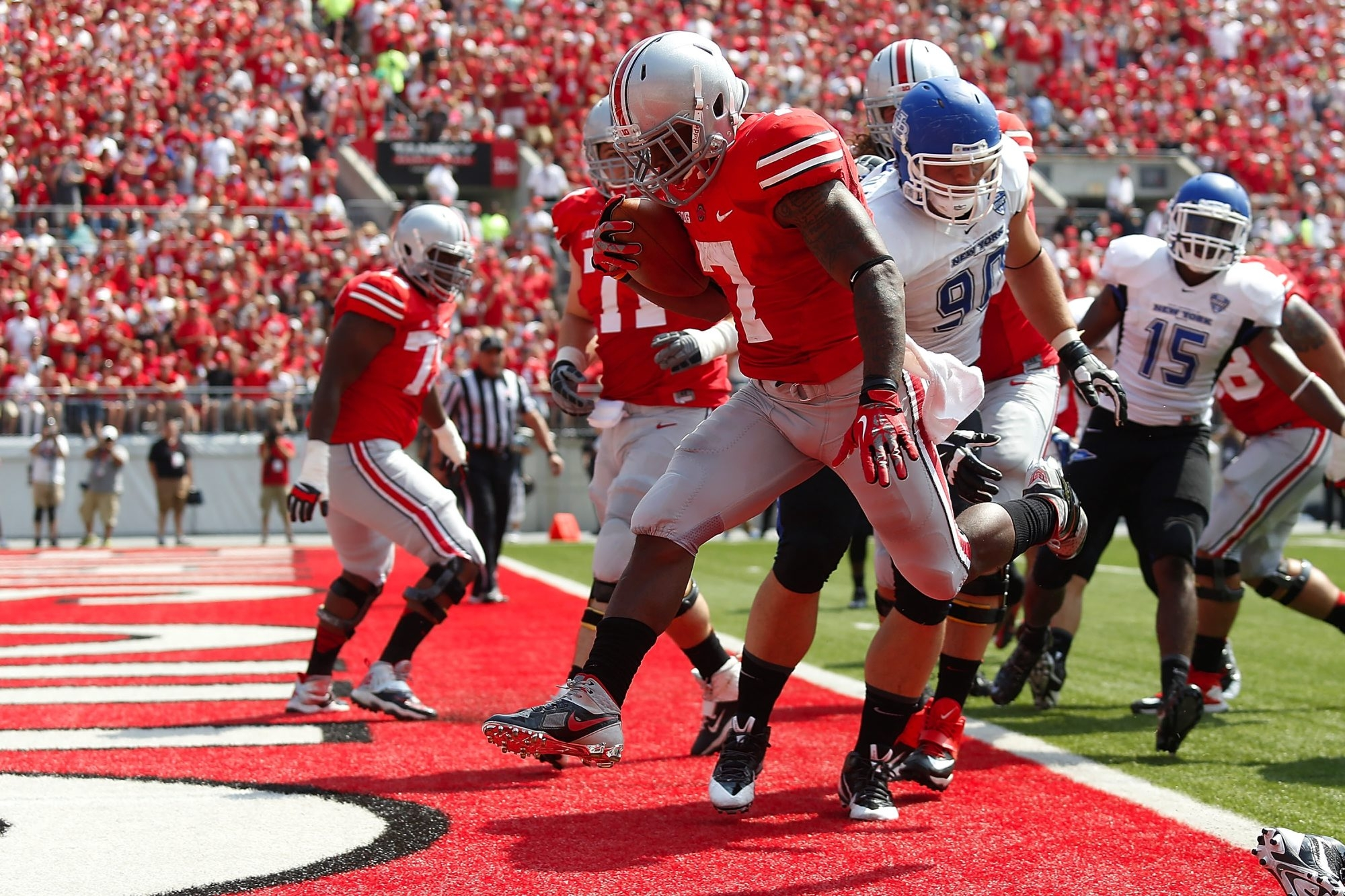 Jordan Hall (7) of Ohio State scores against Buffalo last year in Columbus.  UB was well-compensated to play in that game.
