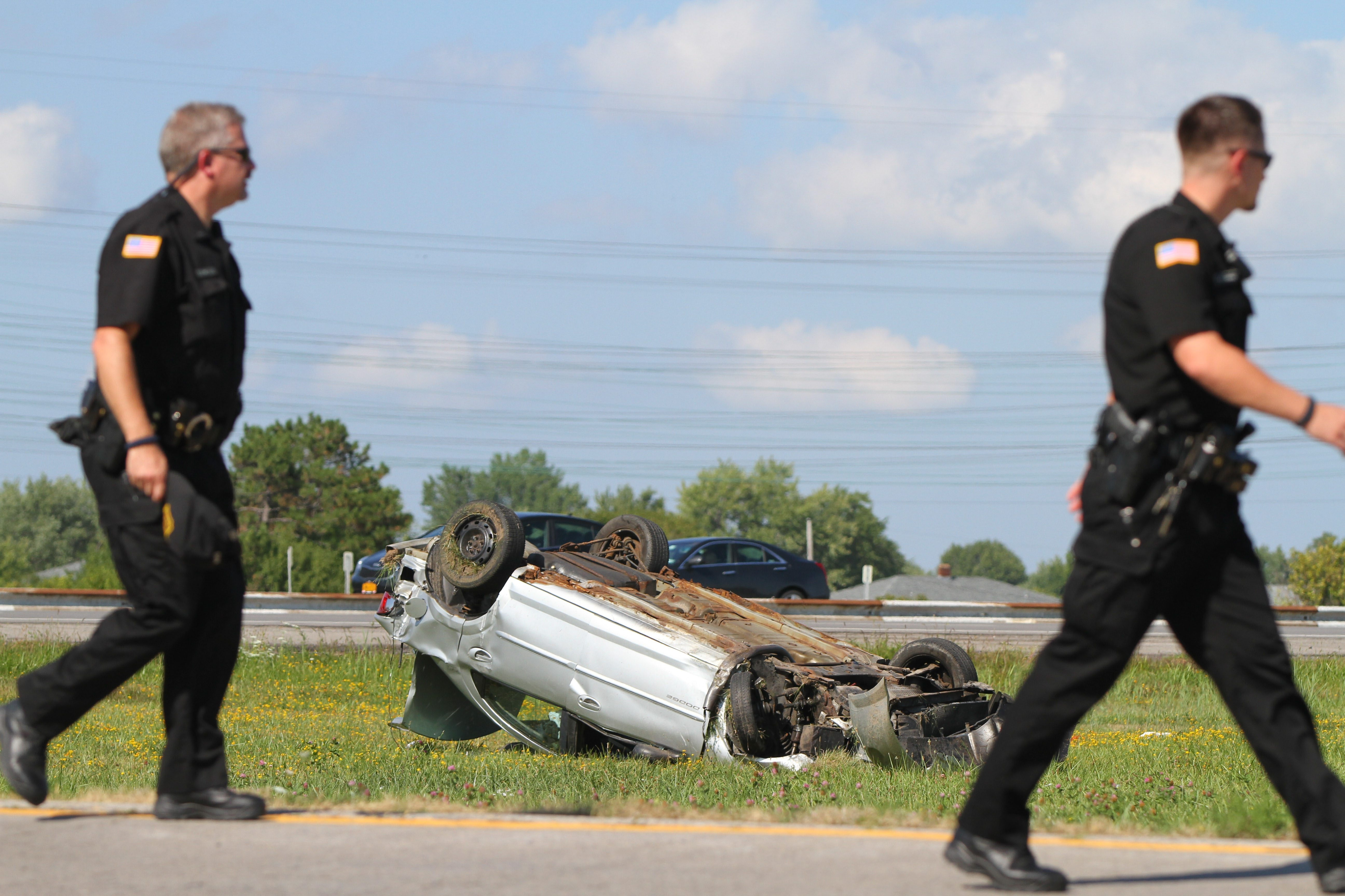 Police officers work on a fatal crash on the I-290 at the Elmwood Ave exit in Tonawanda Tuesday, August 19, 2014.   (Mark Mulville/Buffalo News)