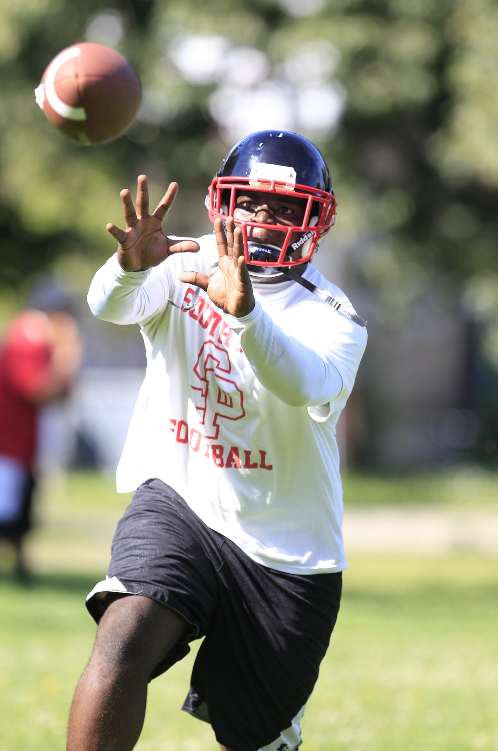 South Park senior Willquan Burgess has his eyes on the ball during the the first day of practice.