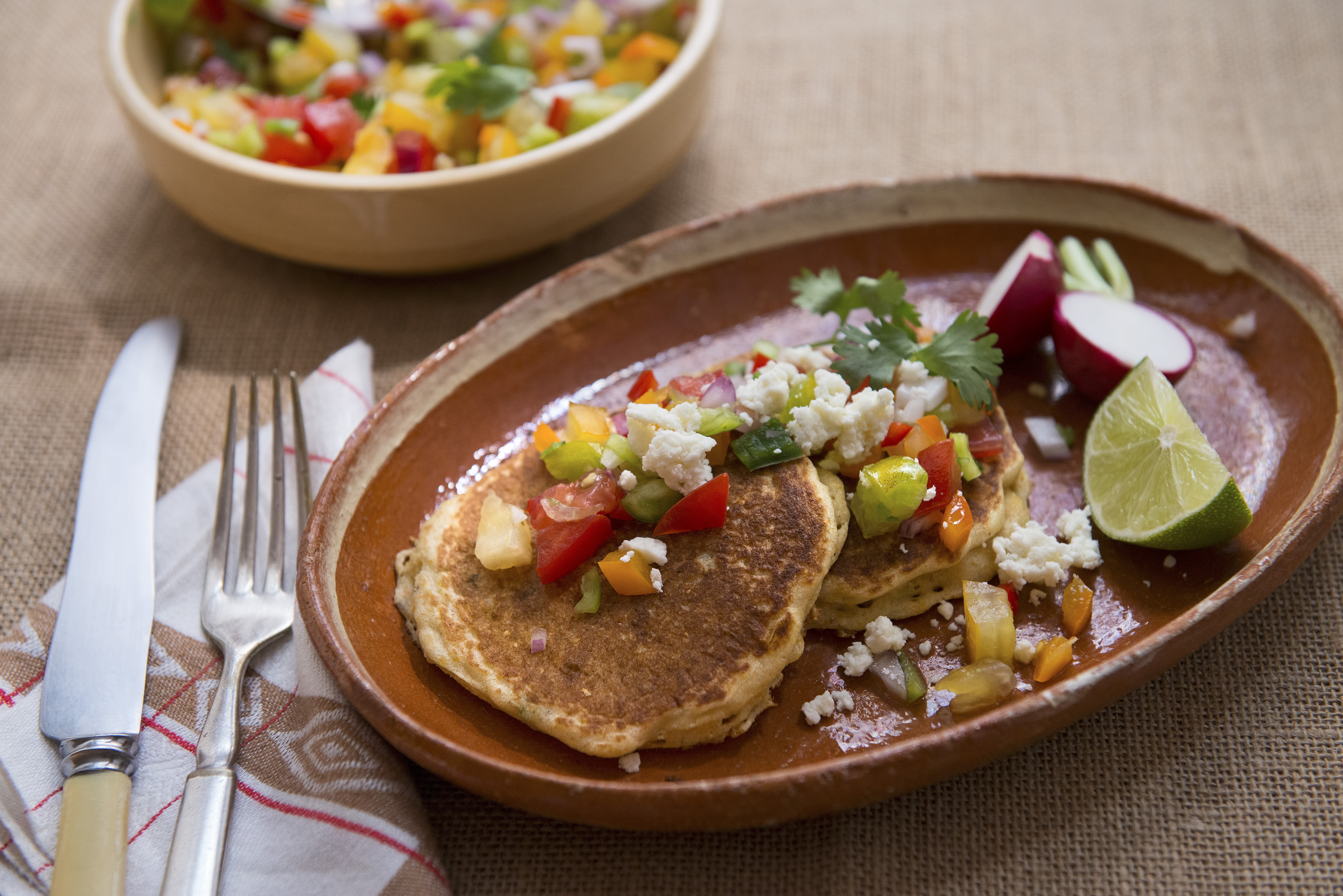 Sweet, tender corn is one of summer's great joys, and the inspiration for this recipe using corn griddle cakes, which are like pancakes but more substantial.