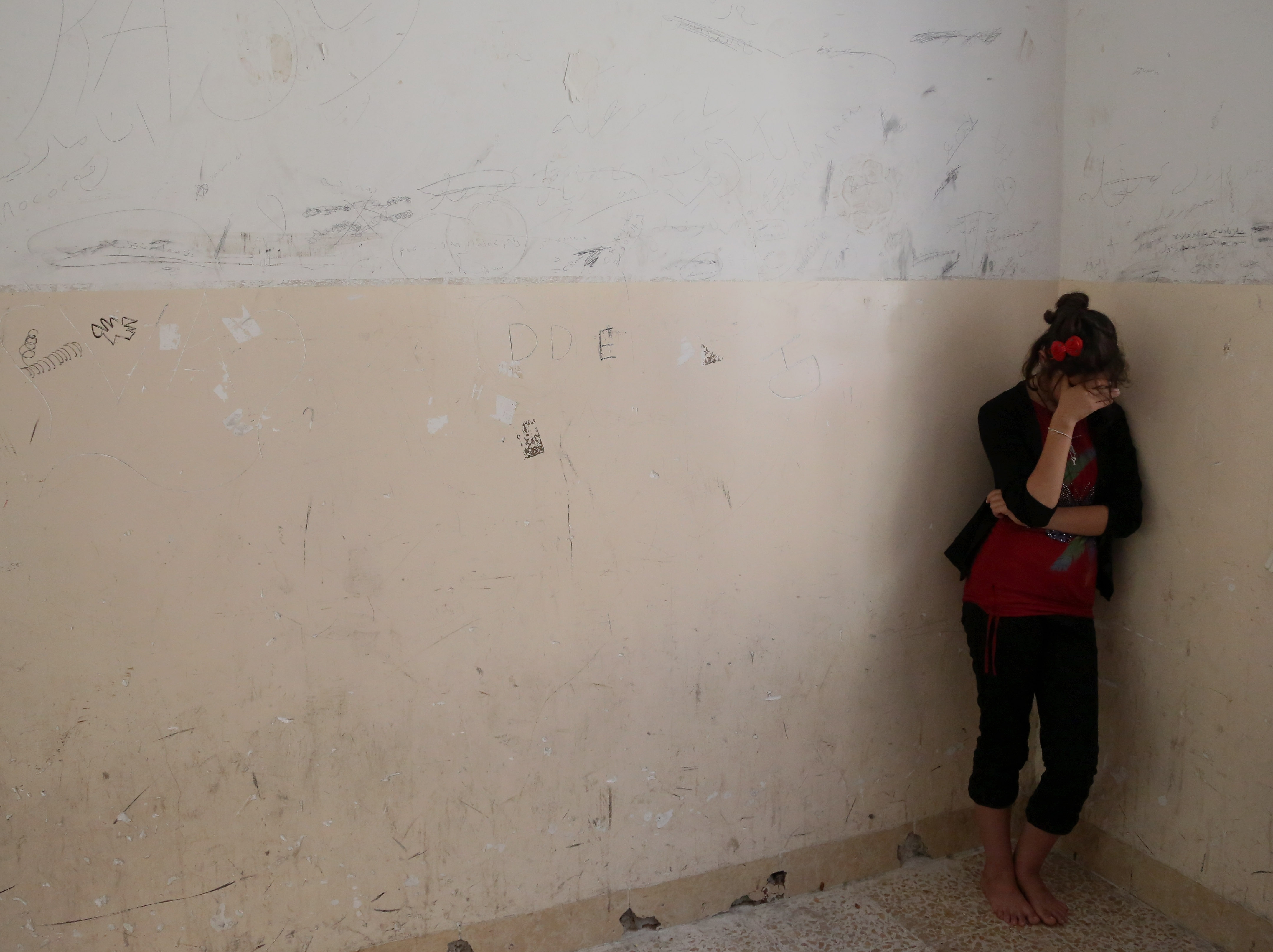 A Yazidi woman cries after Islamic State militants reportedly shot dozens of Yazidi men to death.