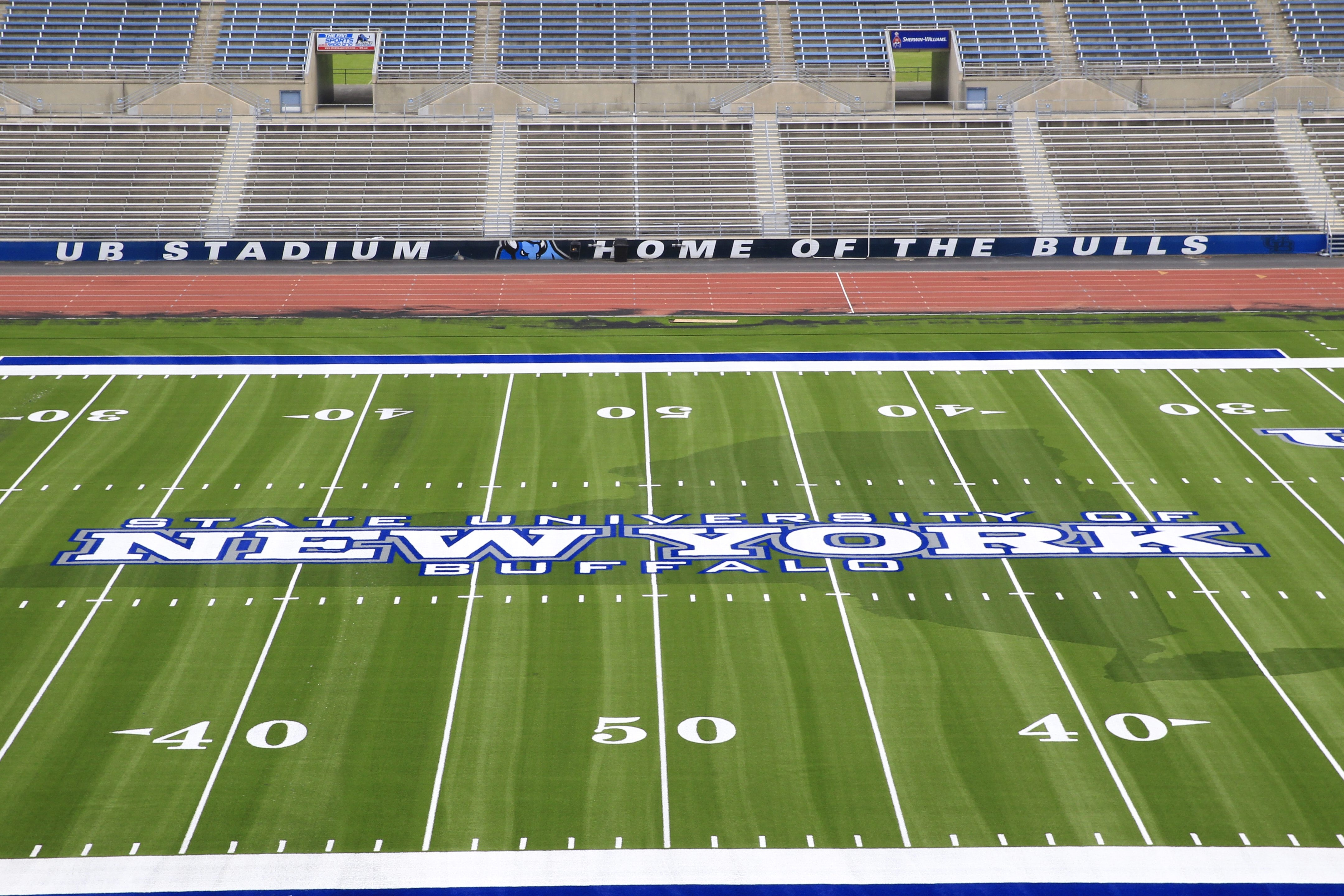 """The field at UB Stadium reflects the new branding effort """"New York Bulls Initiative"""" where the state's name is more prominent than Buffalo."""