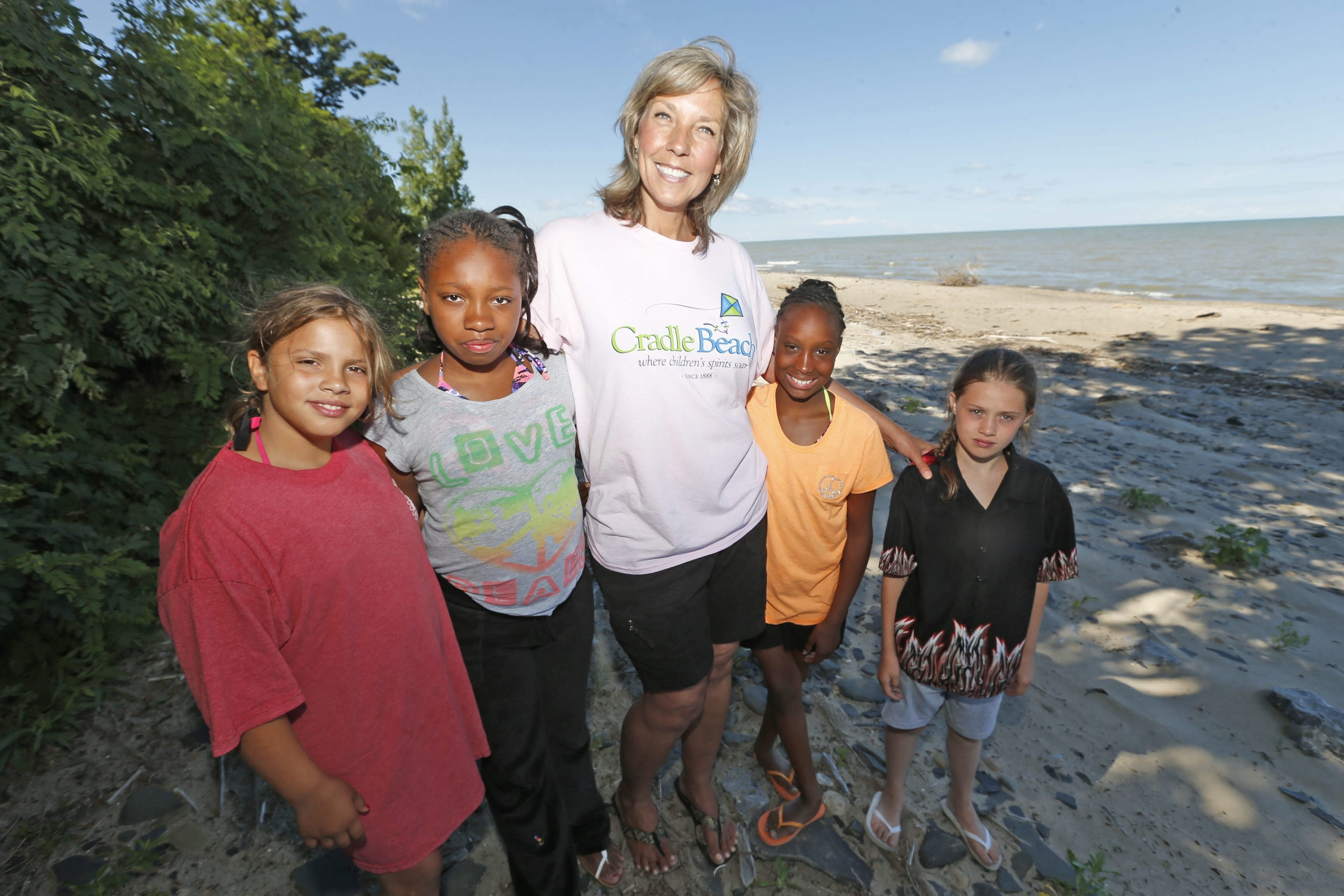 Lynn Kirshey, a special ed coordinator at Niagara Charter School, checks in on students, from left, Shyann Koziel, Diamond Davis-Hall, Andrea Graham and Jackie Phillips, at Cradle Beach in July.