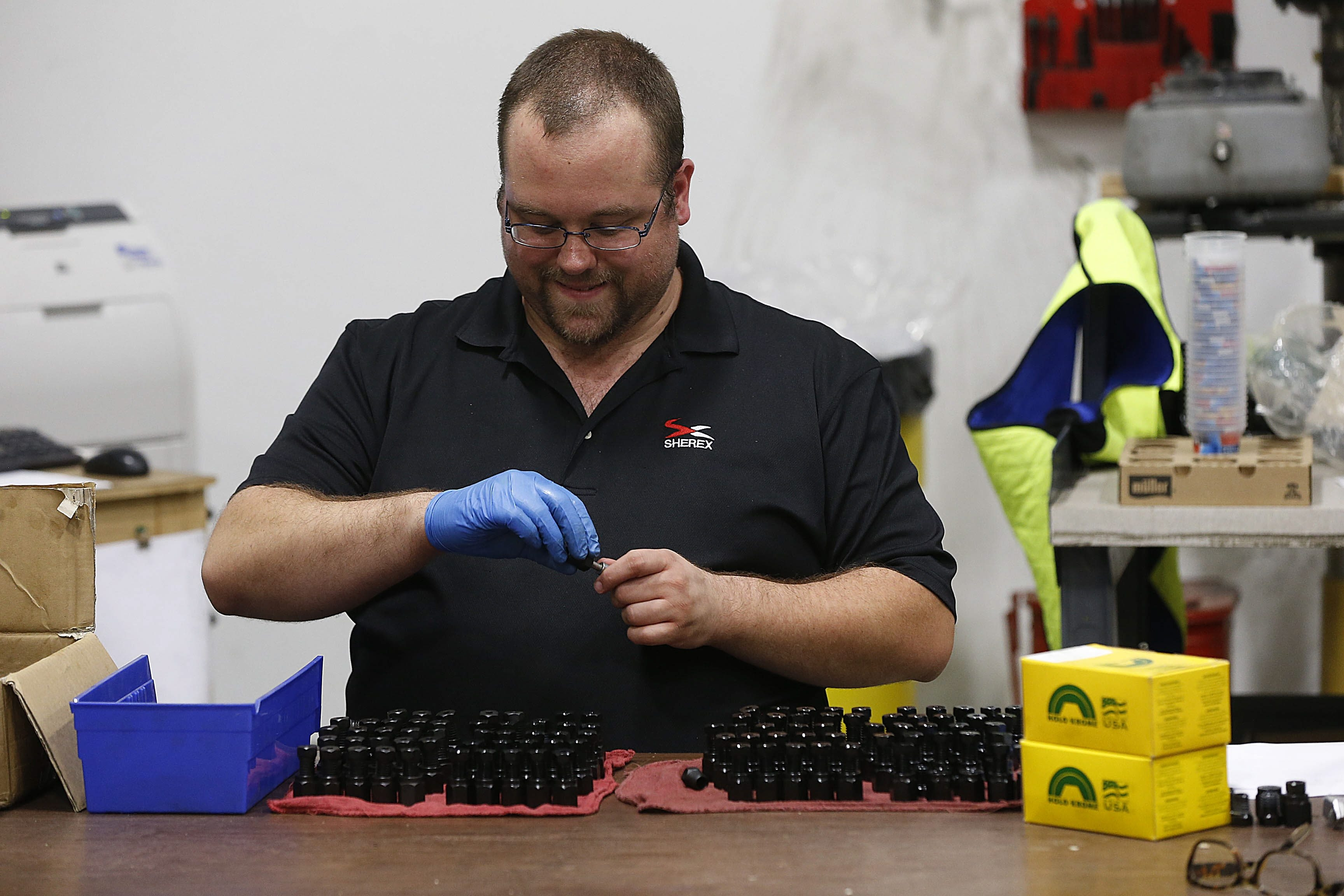 Sherex Fastening Solutions employee Mike Babcock packages tools at the firm's Tonawanda manufacturing facility.