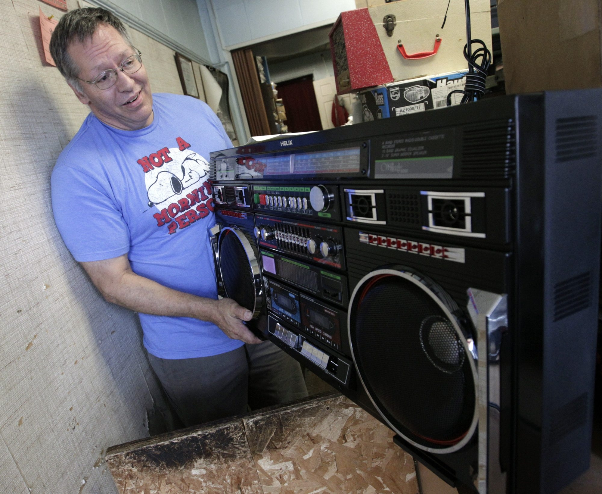 """Jeff Chudy looks over a boom box that was dropped off at his  shop, Precision Audio Service, which he opened in 1979. Chudy has worked on everything from eight tracks to turntables to modern equipment. """"Vinyl's coming back,"""" he said. """"More people are bringing in their old turntables."""""""