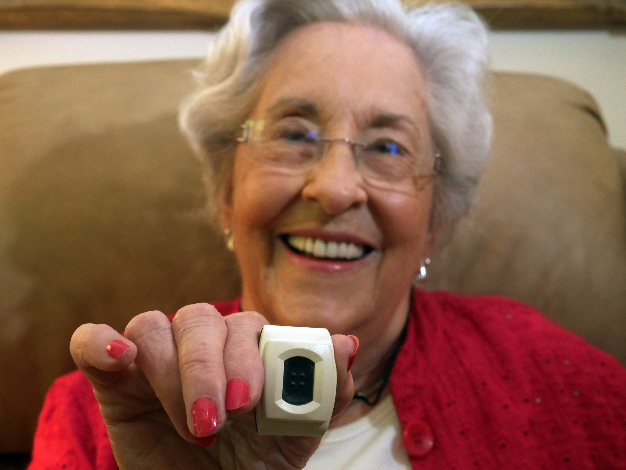 Betty Lewis, 90, a resident at The Plaza at Edgemere in North Dallas, wears the Phillips Life Line, a pendent alert system that informs Edgemere staff when a resident has fallen. The system also gives her general location.