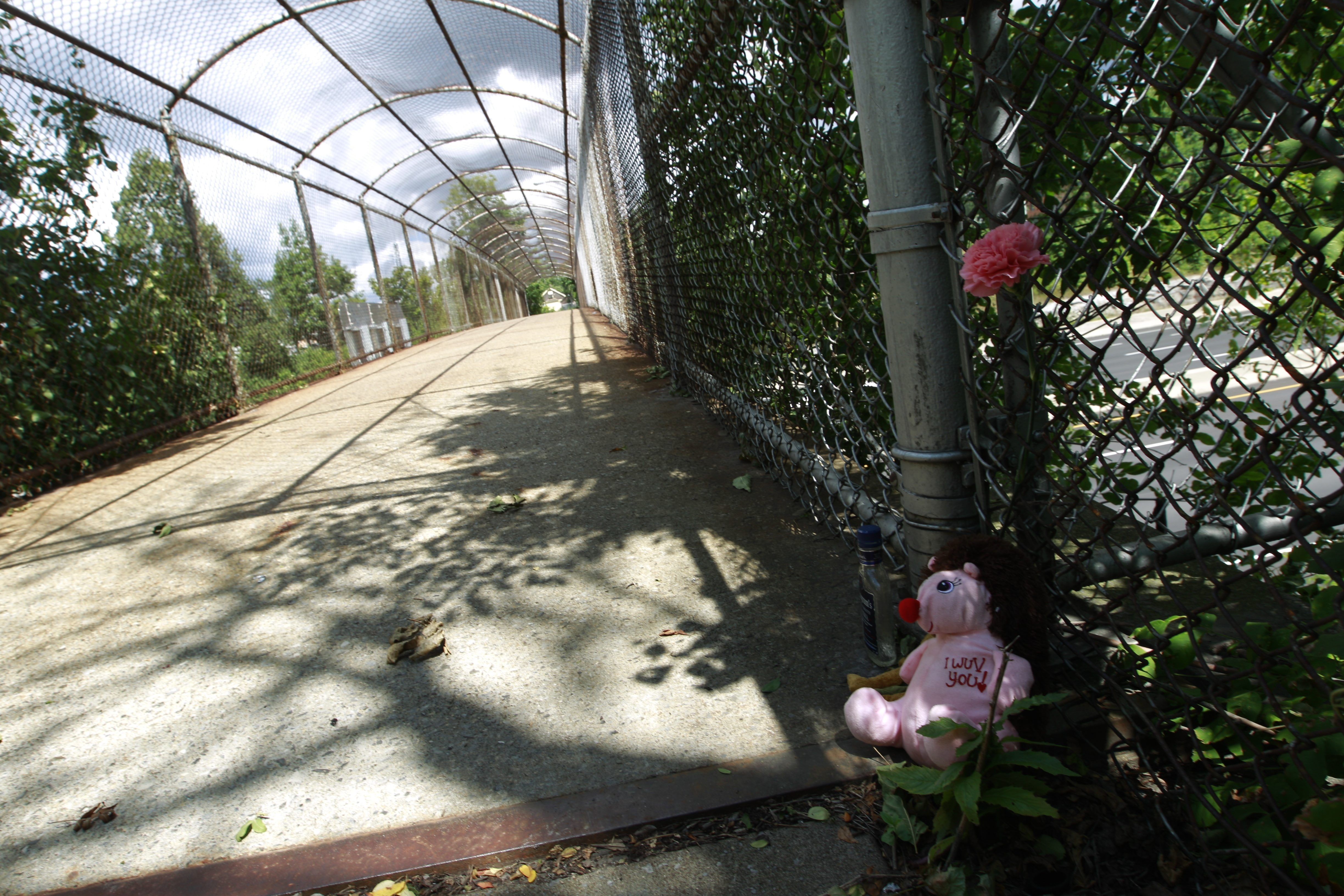 A memorial was left by the pedestrian bridge from Roosevelt Park where a 14-year-old boy was fatally shot and three others wounded Tuesday.  (John Hickey/Buffalo News)
