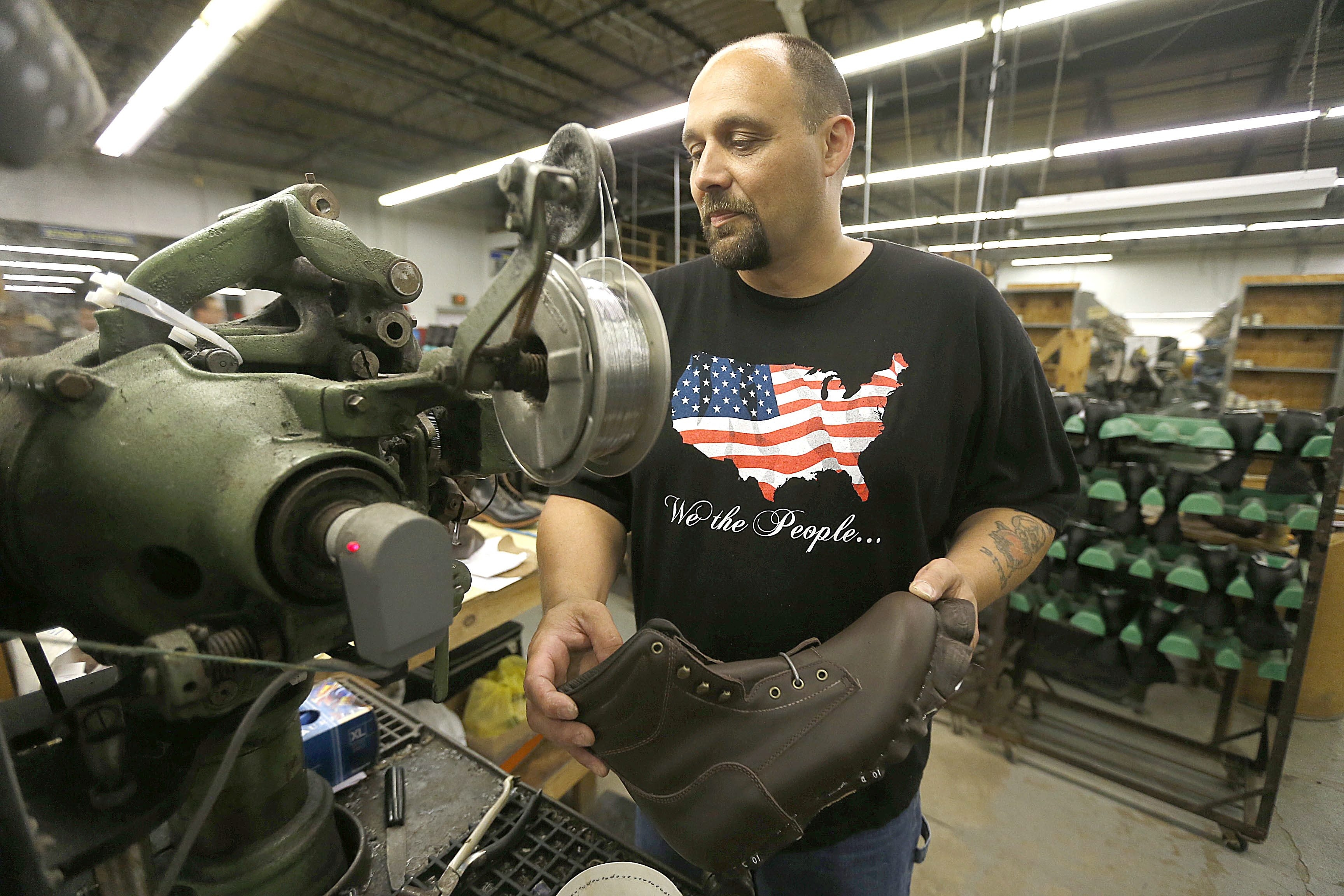 Christopher Hall, one of the six dozen employees facing job loss after the June announcement that P.W. Minor & Sons would close, finishes boots at the Batavia factory as a change in ownership has energized the workers and the community about a better future.