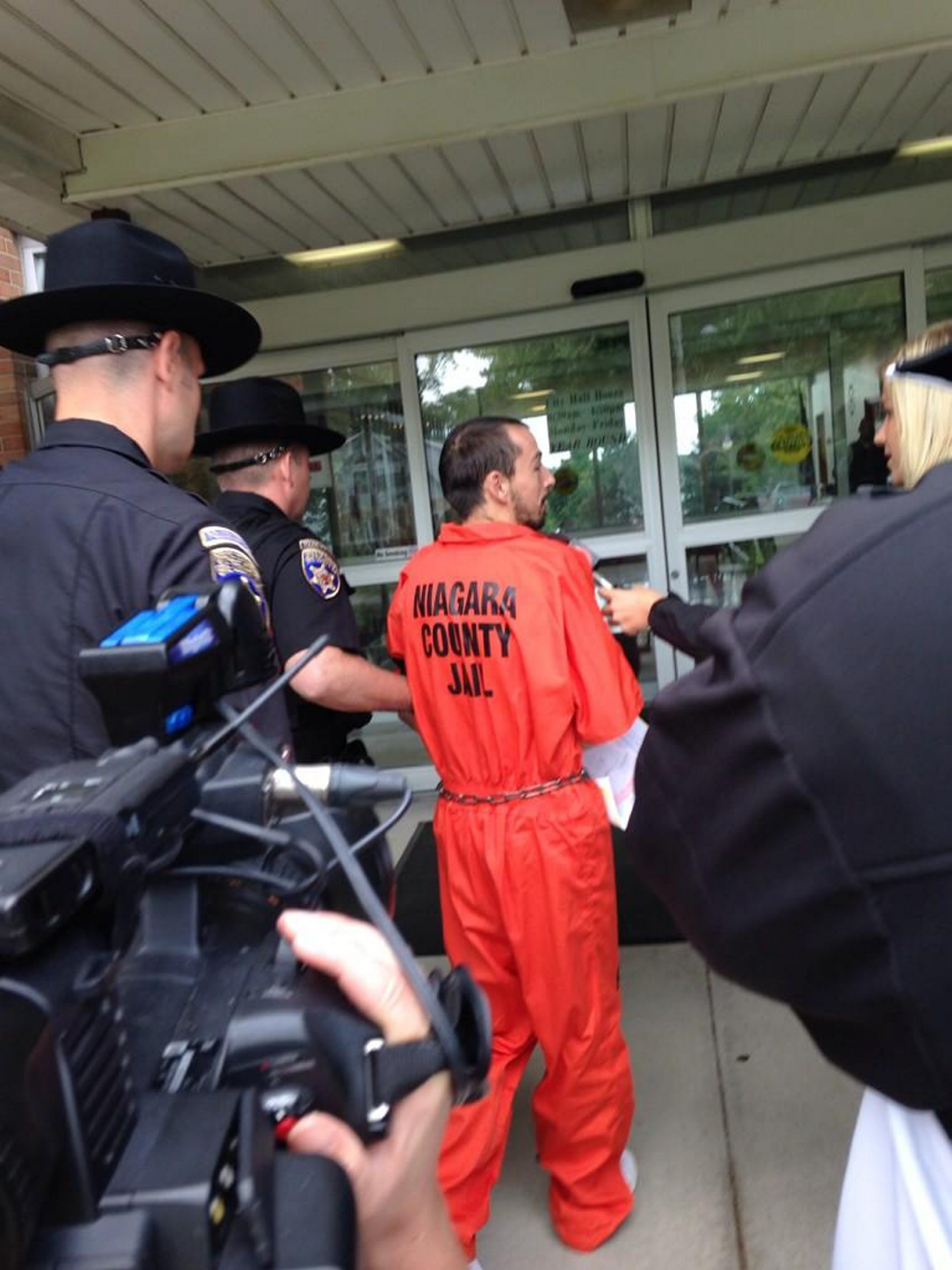 Arson suspect Christopher Syracuse is led into City of Tonawanda court today. (Lisa Khoury)