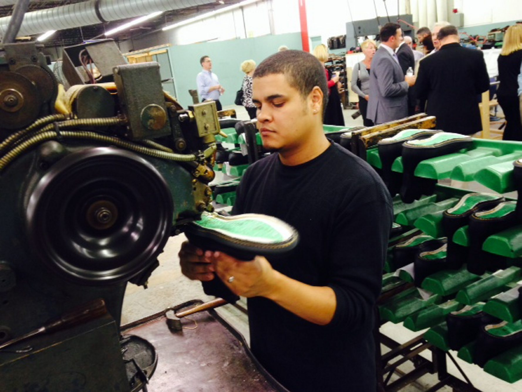 Jordan Brooks inseams a work boot at the PW Minor shoe company in Batavia. (Robert Kirkham/Buffalo News)