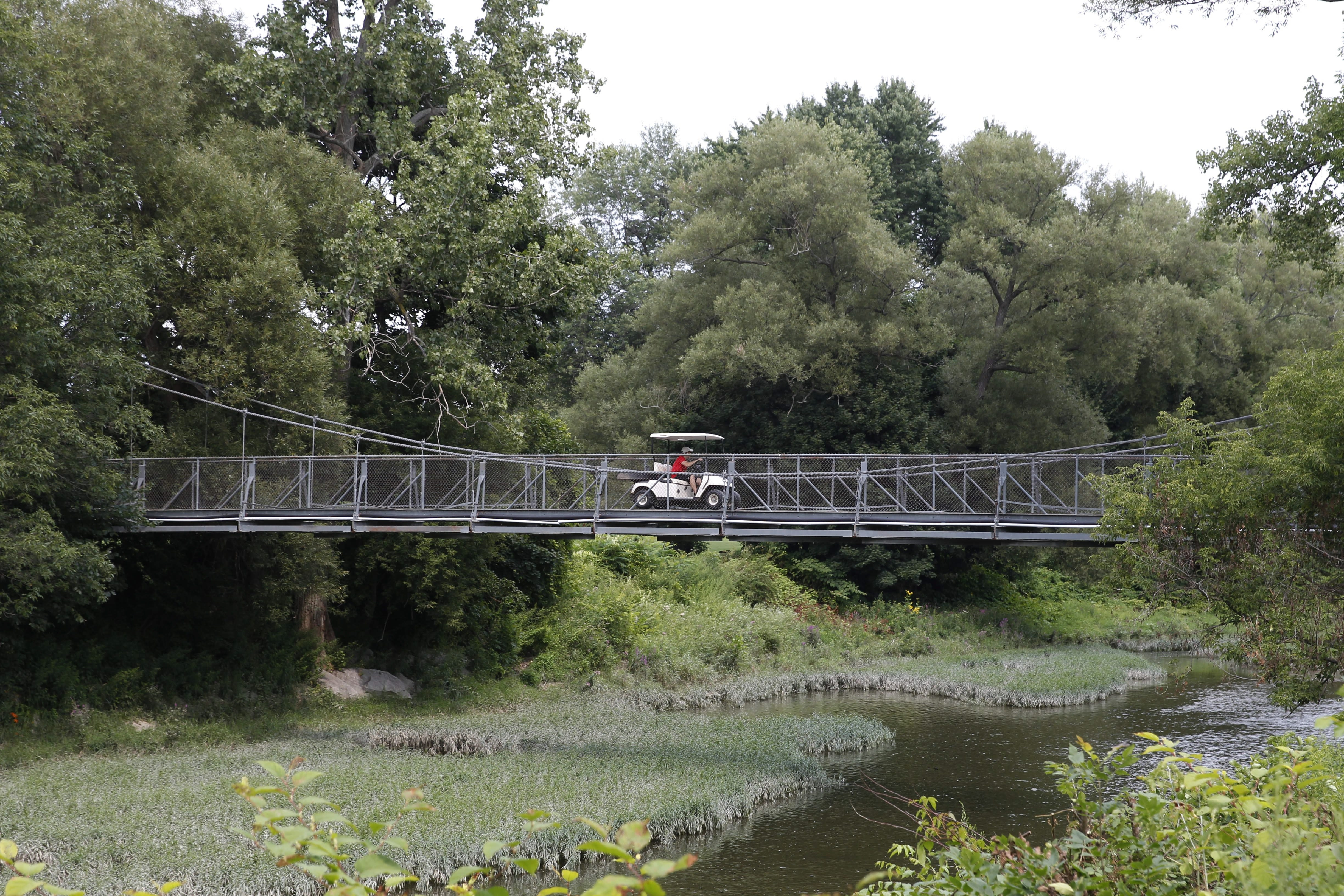 There are hidden gems in each of the Olmsted Parks in Buffalo.  Buffalo's suspension bridge is on the golf course over the Cazenovia Creek at Cazenovia Park.  It was built in the 1930s.   Photo taken Friday, Aug. 8, 2014.  (Sharon Cantillon/Buffalo News)