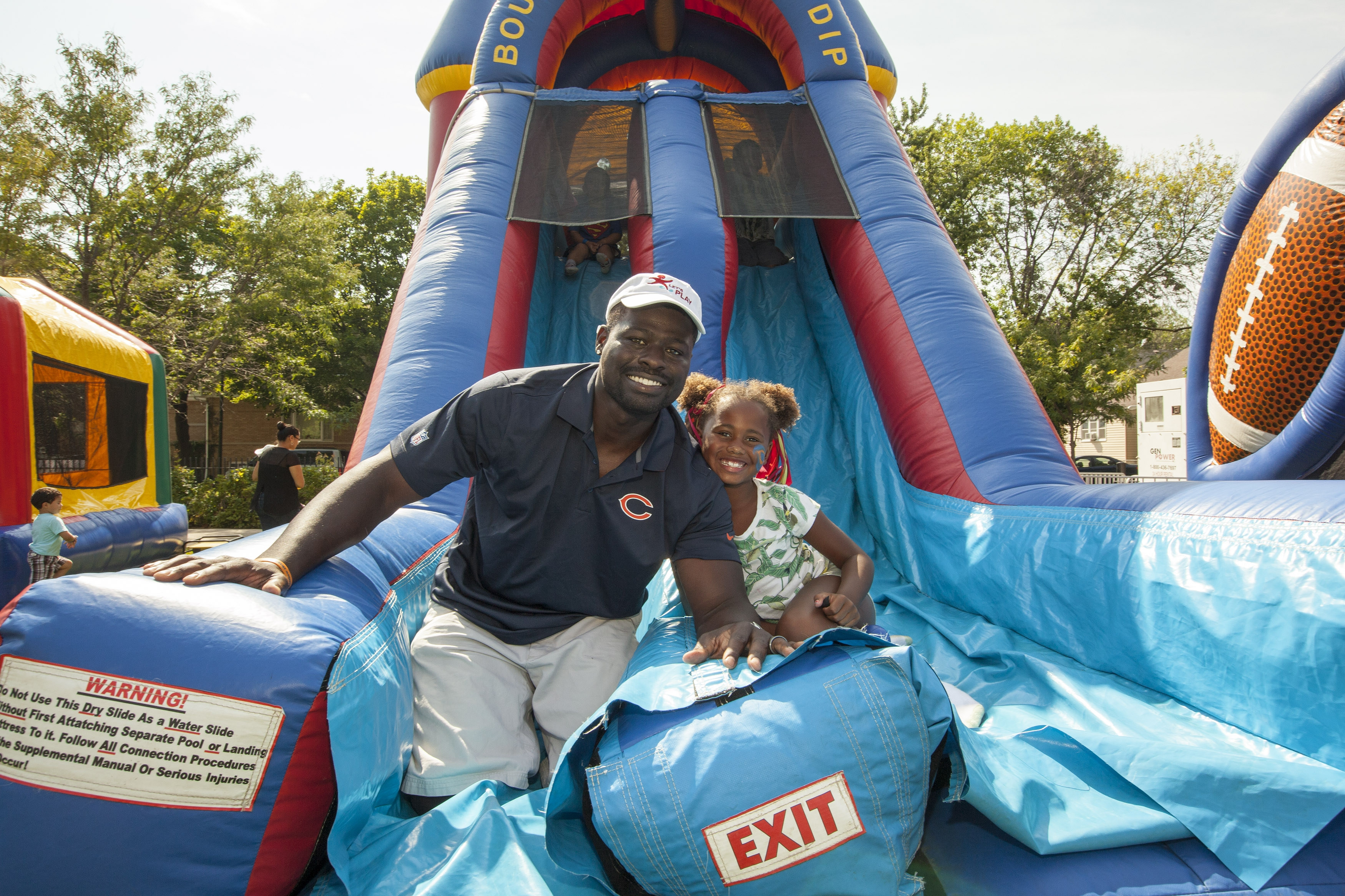 "Kids at play: Former Chicago Bears defensive end Alex Brown and his daughter were at ""Let's Play Chicago"" Monday in the Windy City. The free event encouraged kids and families to get active."