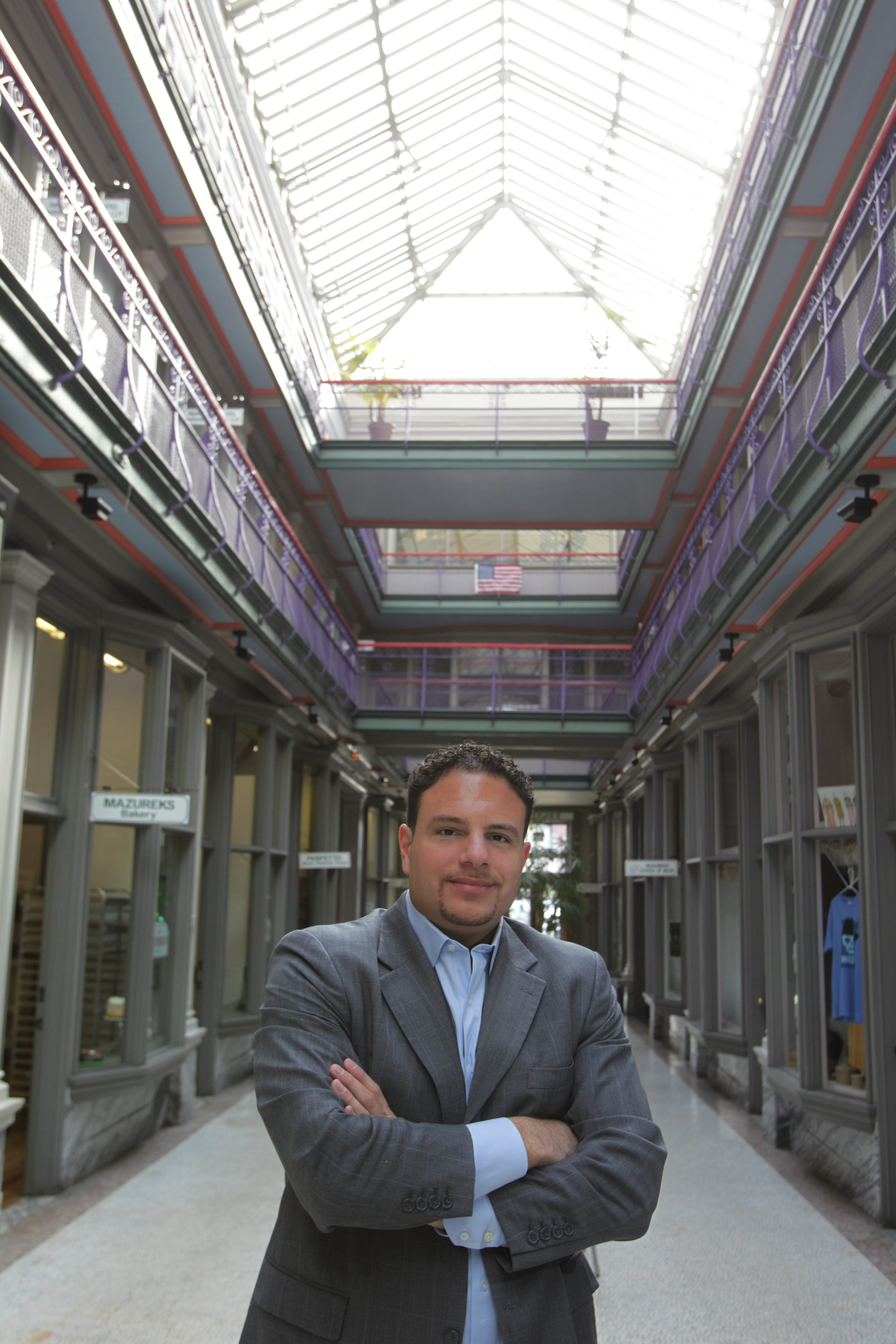 Up-and-coming developer Nick Sinatra is buying the Market Arcade for his firm's new headquarter and is redeveloping the Fenton Village apartments on Main St, among other projects. Sinatra was photographed at the Market Arcade, Monday, March 24, 2014.  (Sharon Cantillon/Buffalo News)