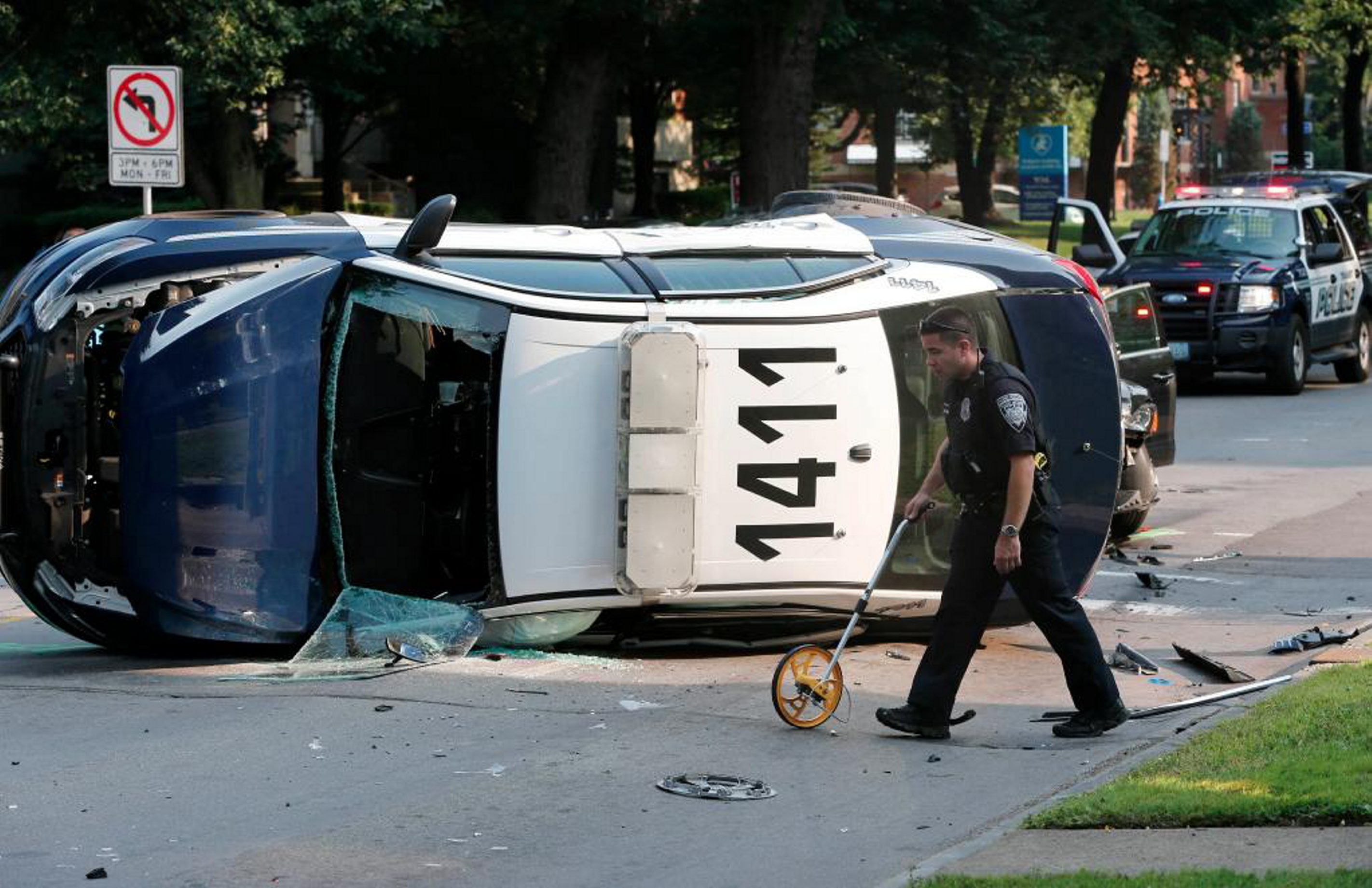 Police investigate after a collision at Delaware Avenue and Bryant Street left an NFTA police vehicle on its side Friday morning, Aug. 8, 2014. (Derek Gee/Buffalo News).