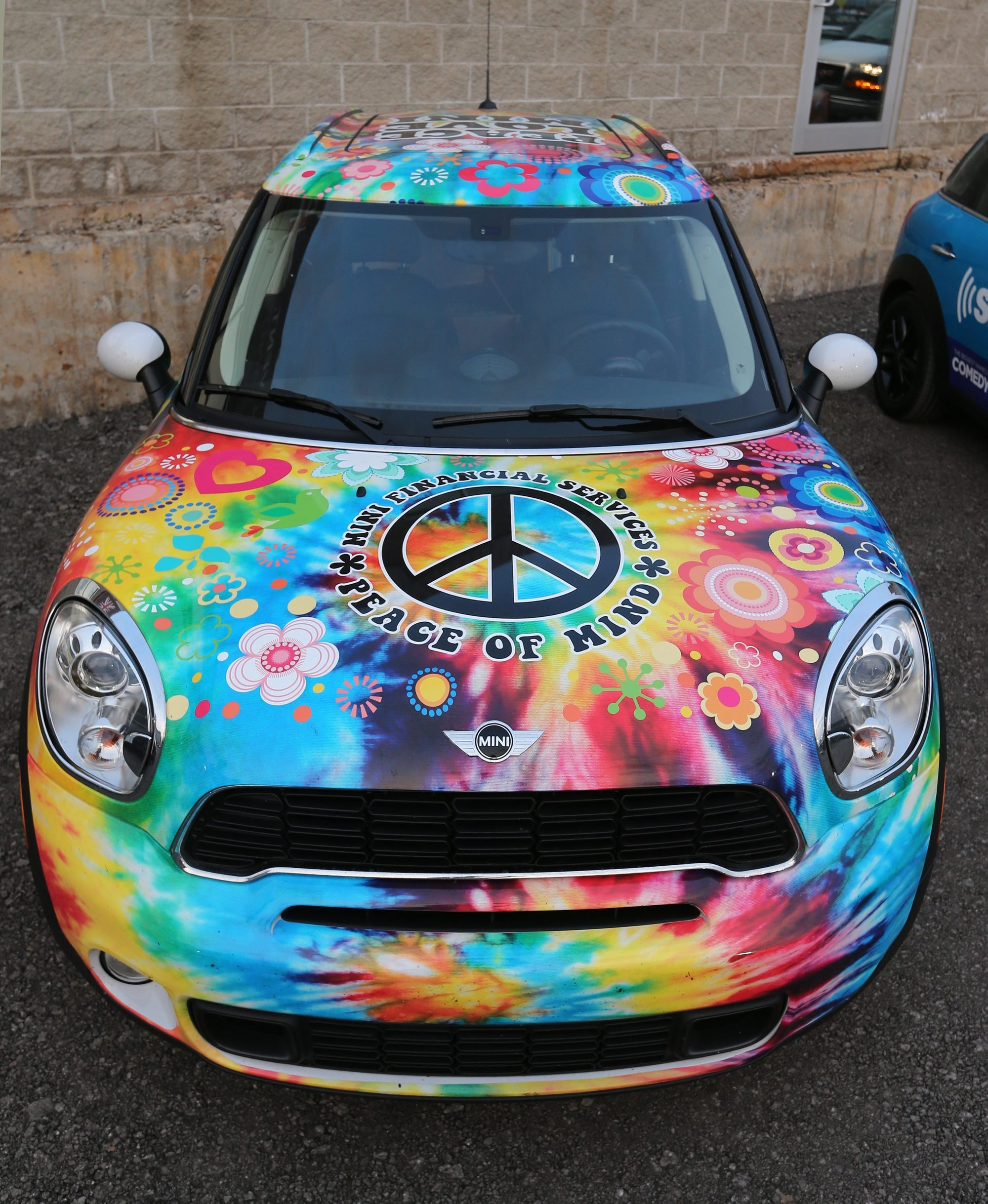 A Mini with a psychedelic paint job at Mini Takes the States.