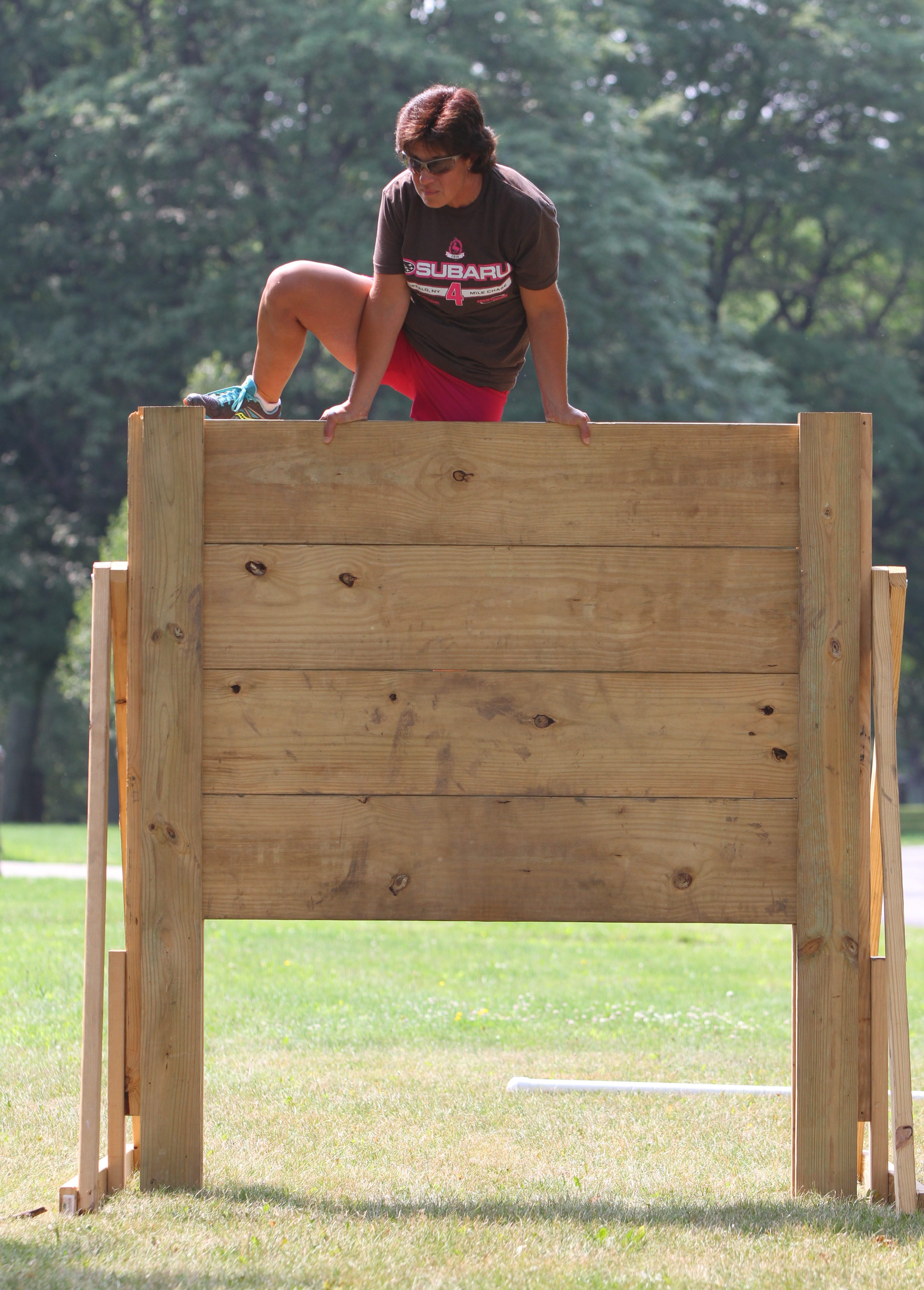 Amy Garten leaps an obstacle getting ready for the Wild Women Unite weekend at Beaver Island State Park on Grand Island.