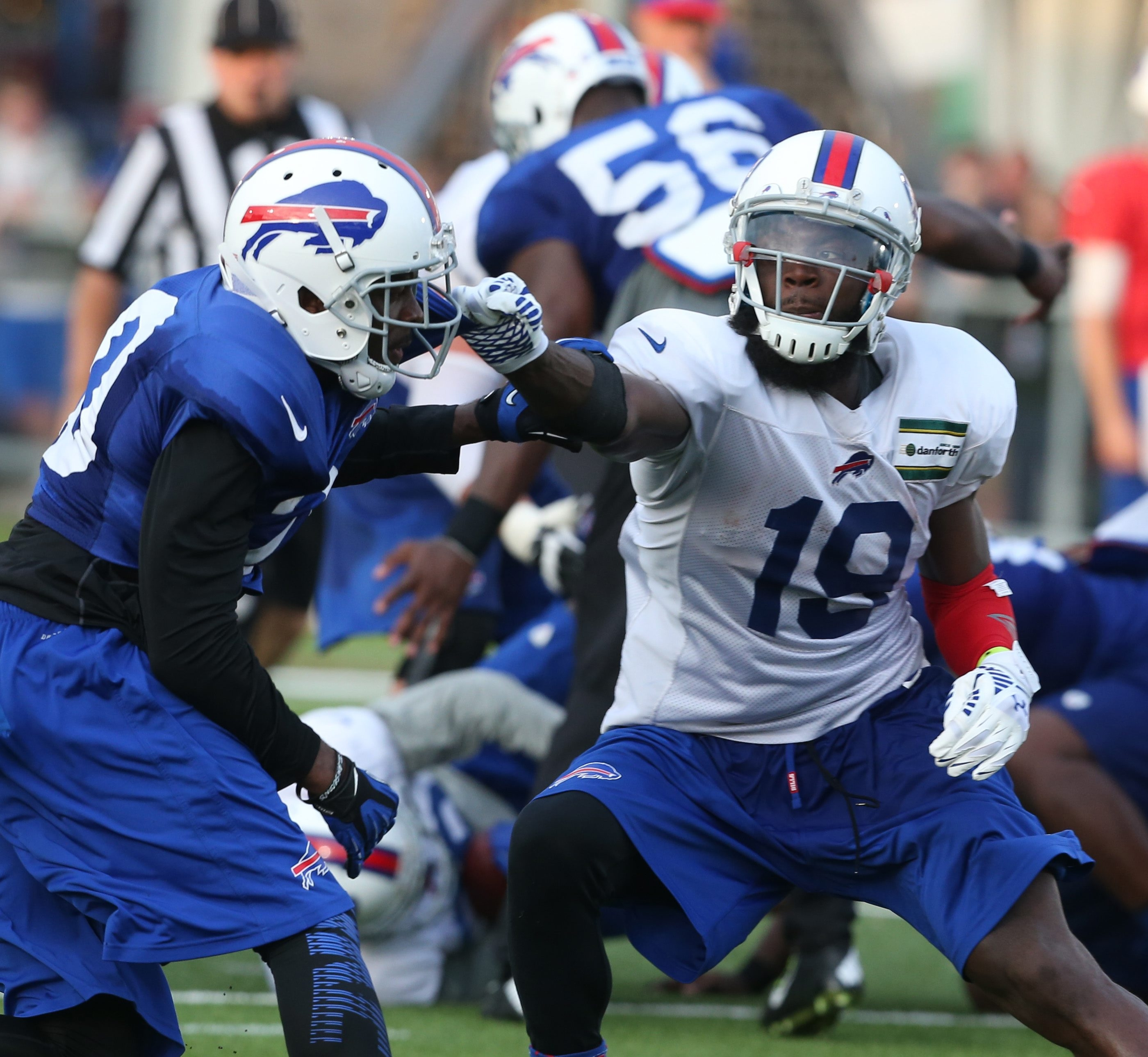 Bills receiver Mike Williams, right, blocks fellow Buffalo native Corey Graham during Tuesday's practice at St. John Fisher College.