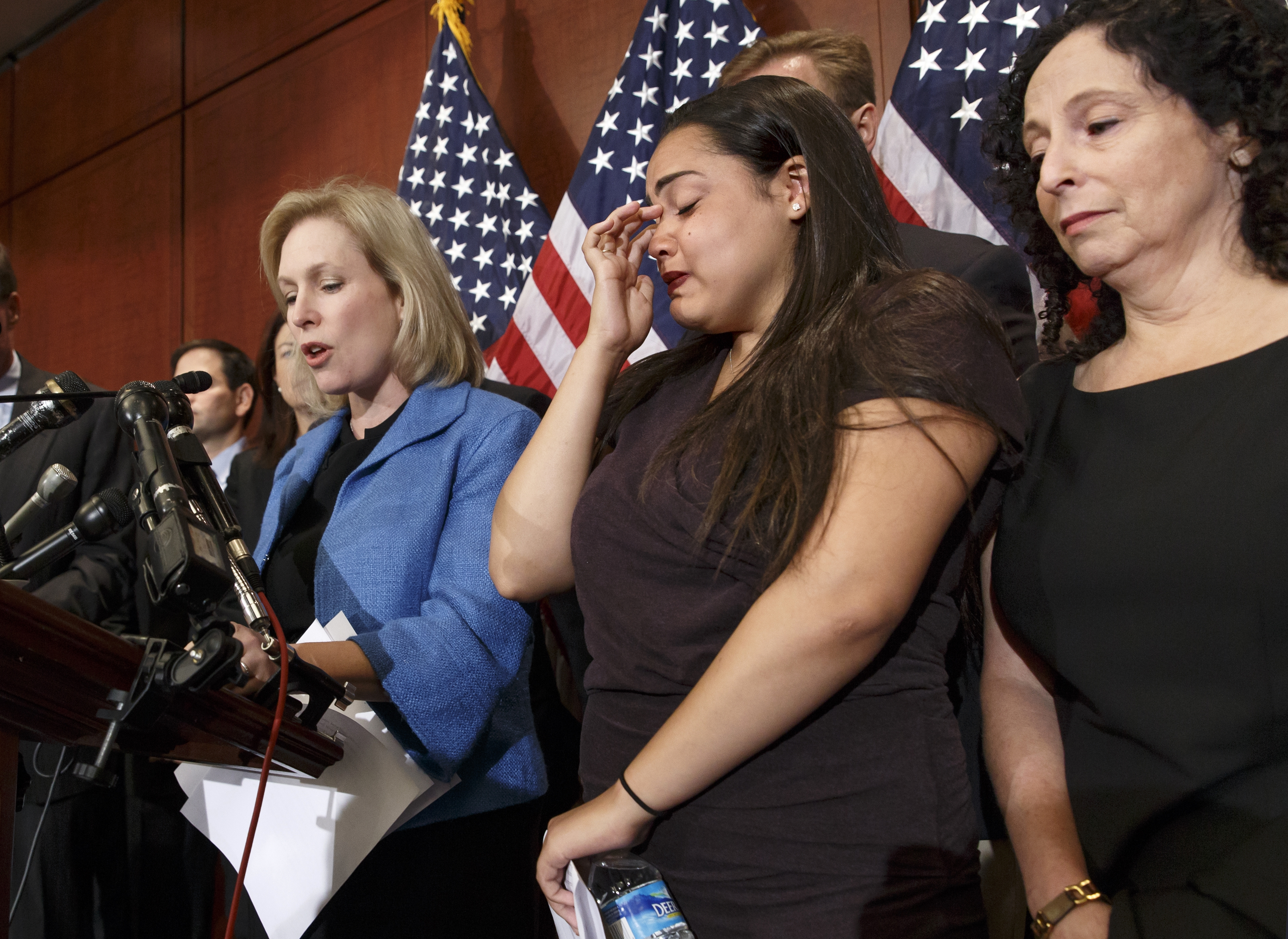 """Anna, center, a victim of sexual assault on campus, with her mother Susan, right, joined Sen. Kirsten Gillibrand, D-N.Y.,to discuss the """"Campus Accountability and Safety Act."""" (AP photo)"""