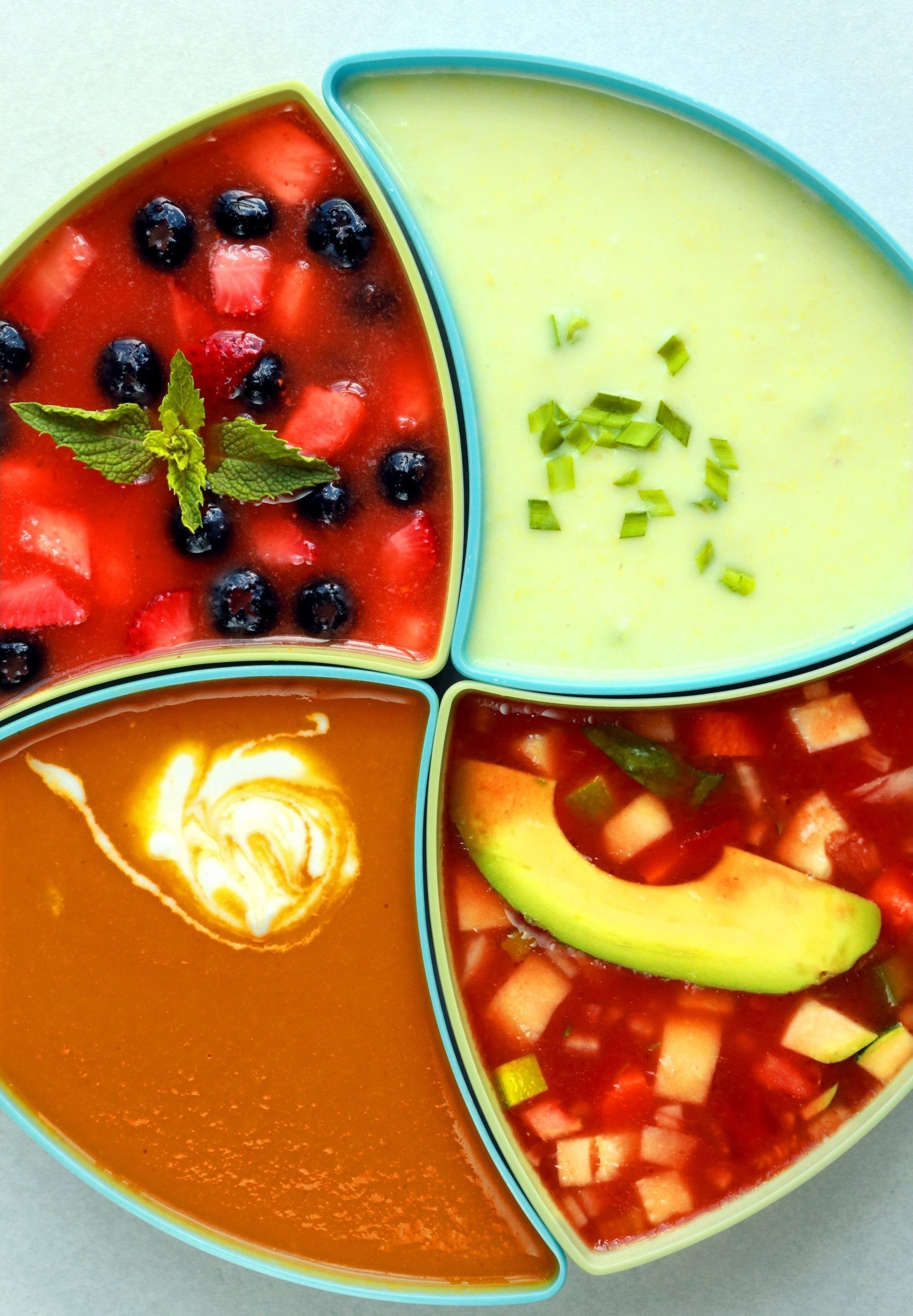 Cold soups can be the perfect response to a sticky summer day. Some varieties include, clockwise from top right, Cold Corn Vichyssoise, Farmers Market Gazpacho, Ginger Carrot Soup and Summer Fruit Soup. (Christian Gooden/St. Louis Post-Dispatch/TCA)