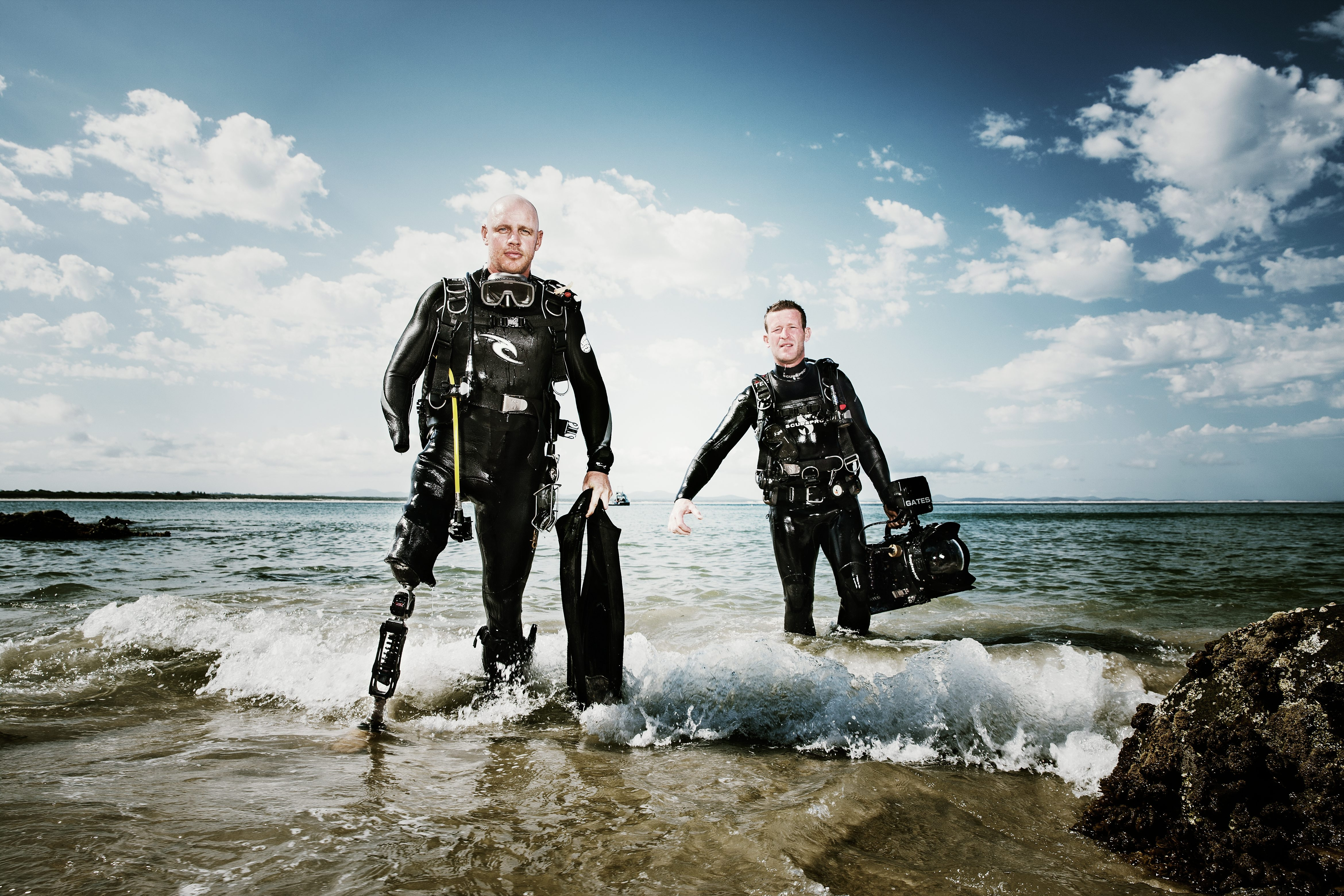 Shark attack survivor Paul de Gelder, left, and Andy Casagrande are featured during Shark Week, beginning today on the Discovery Channel.
