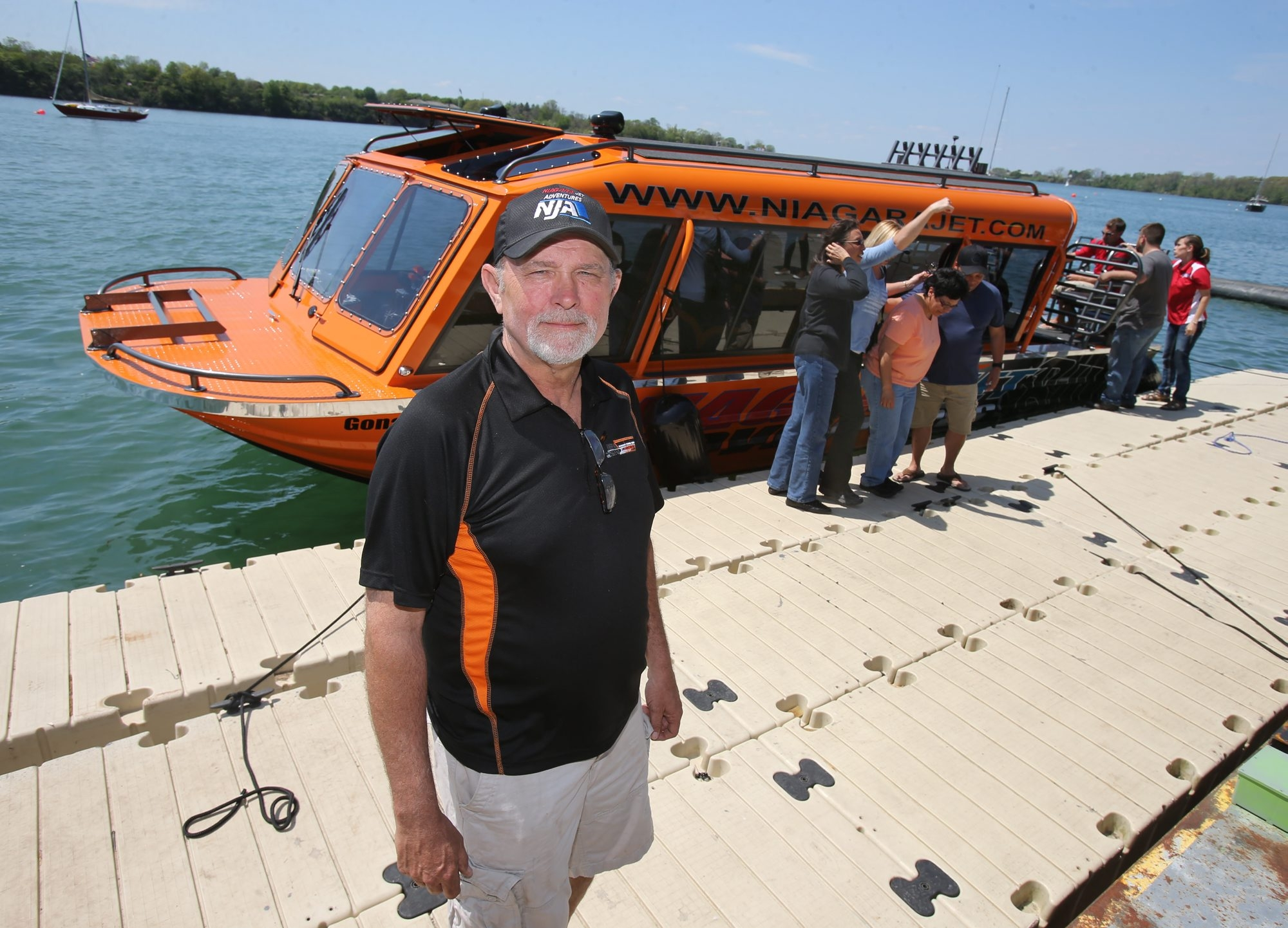 Mike Fox, owner of Niagara Jet Adventures, stands near a jet boat at Fox Boyz Marina in Youngstown recently.