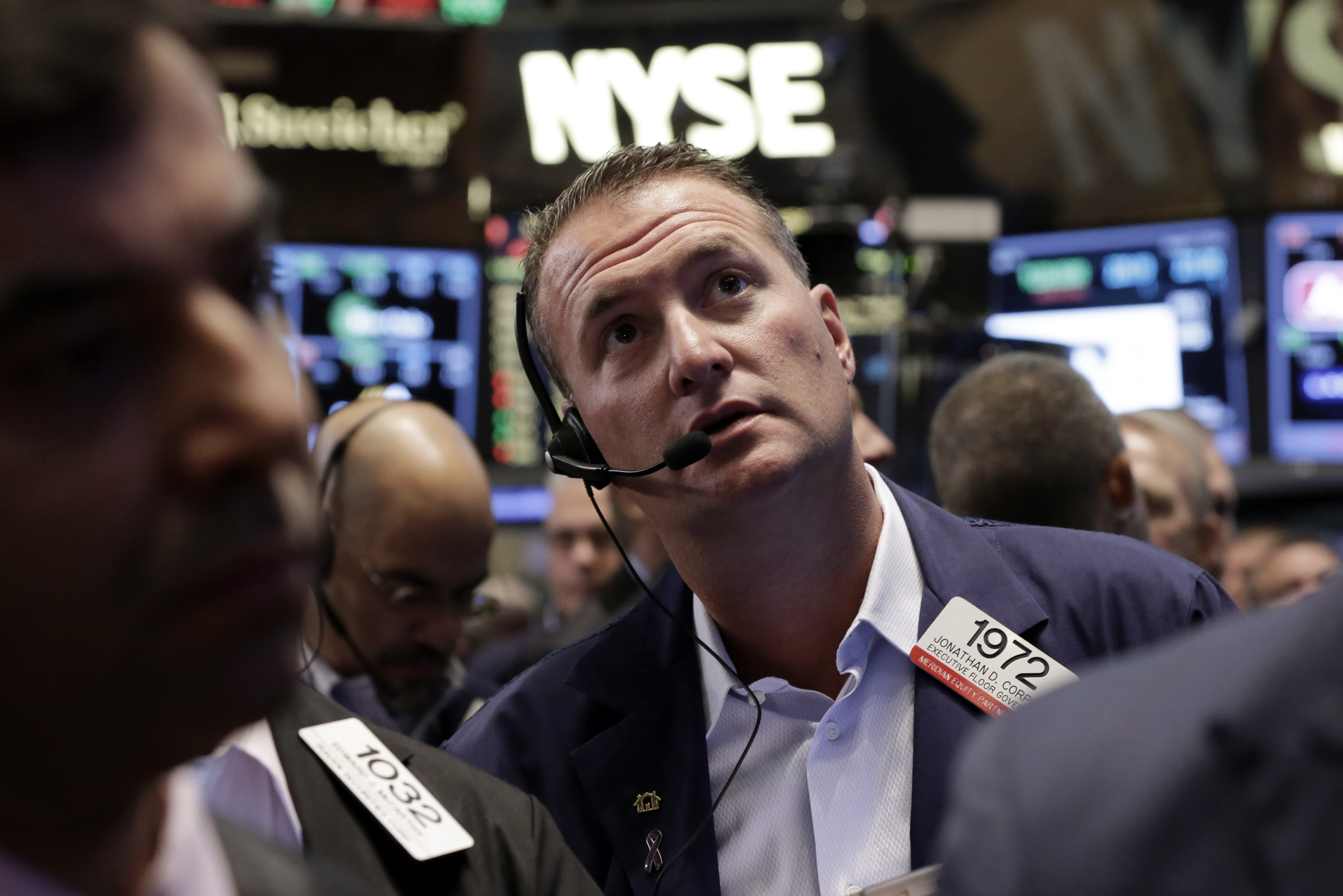At the New York Stock Exchange, Jonathan Corpina is among the traders on the floor who are welcoming a steadying of the market after last week's big sell-off that negated July's gains.
