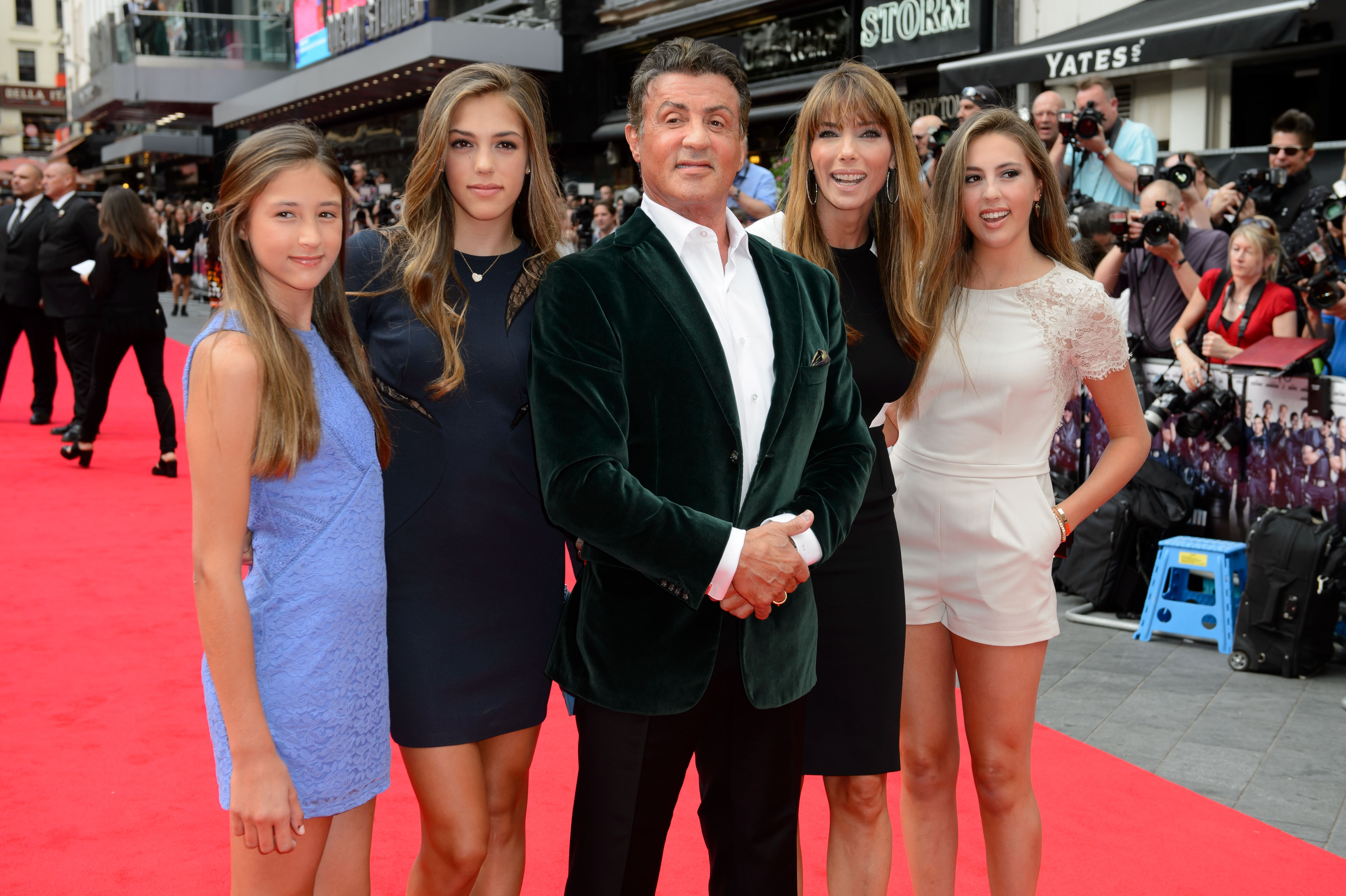 "Actor Sylvester Stallone with his wife, Jennifer Flavin, and daughters, Sophia, Sistene and Scarlet arrive for the world premiere of ""The Expendables 3"" at a central London theater Monday."