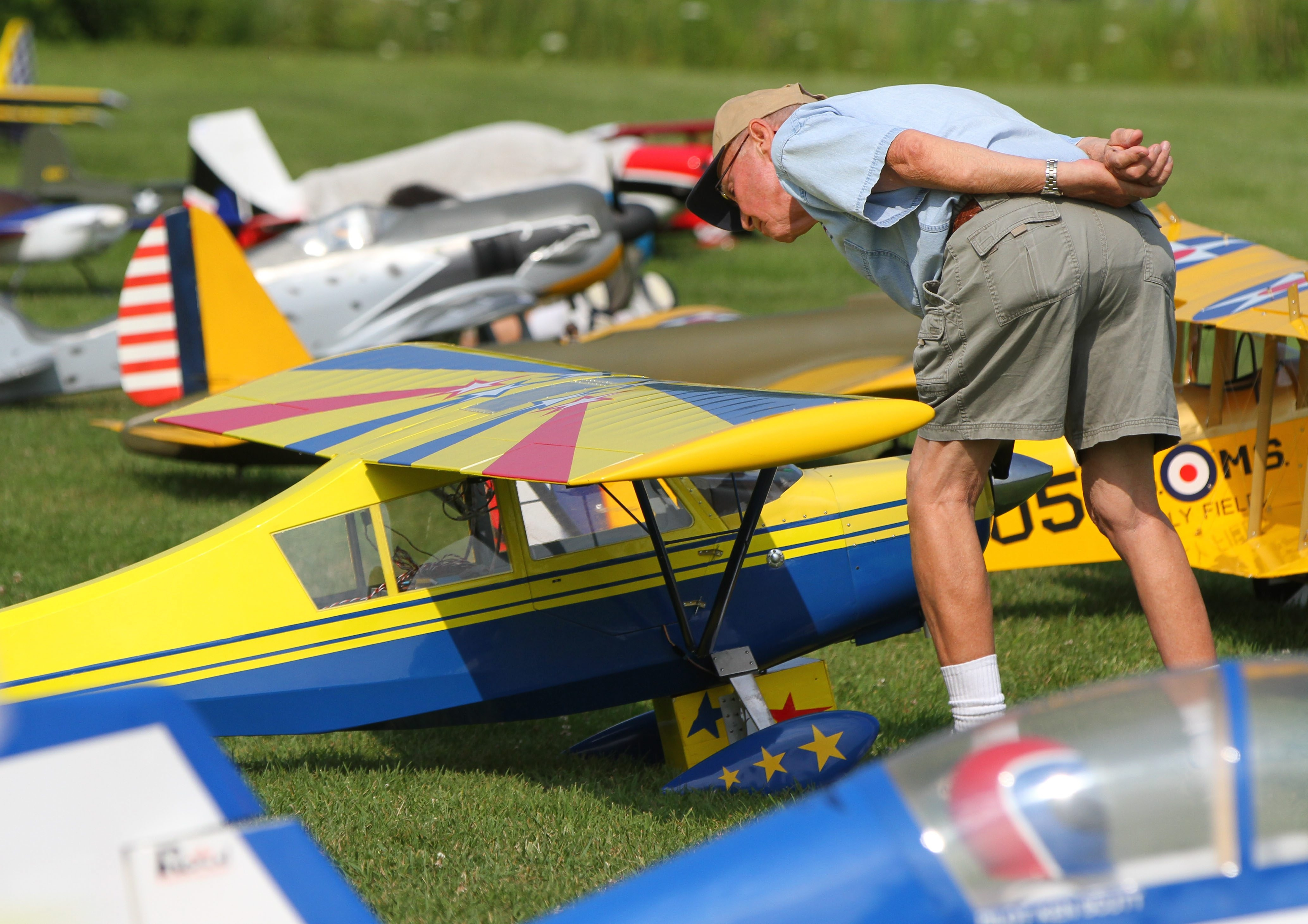 Ron Ogren of Orchard Park looks over a plane during the Flying Knights of Hamburg's Model Aircraft Scale Rally in Hamburg Saturday.