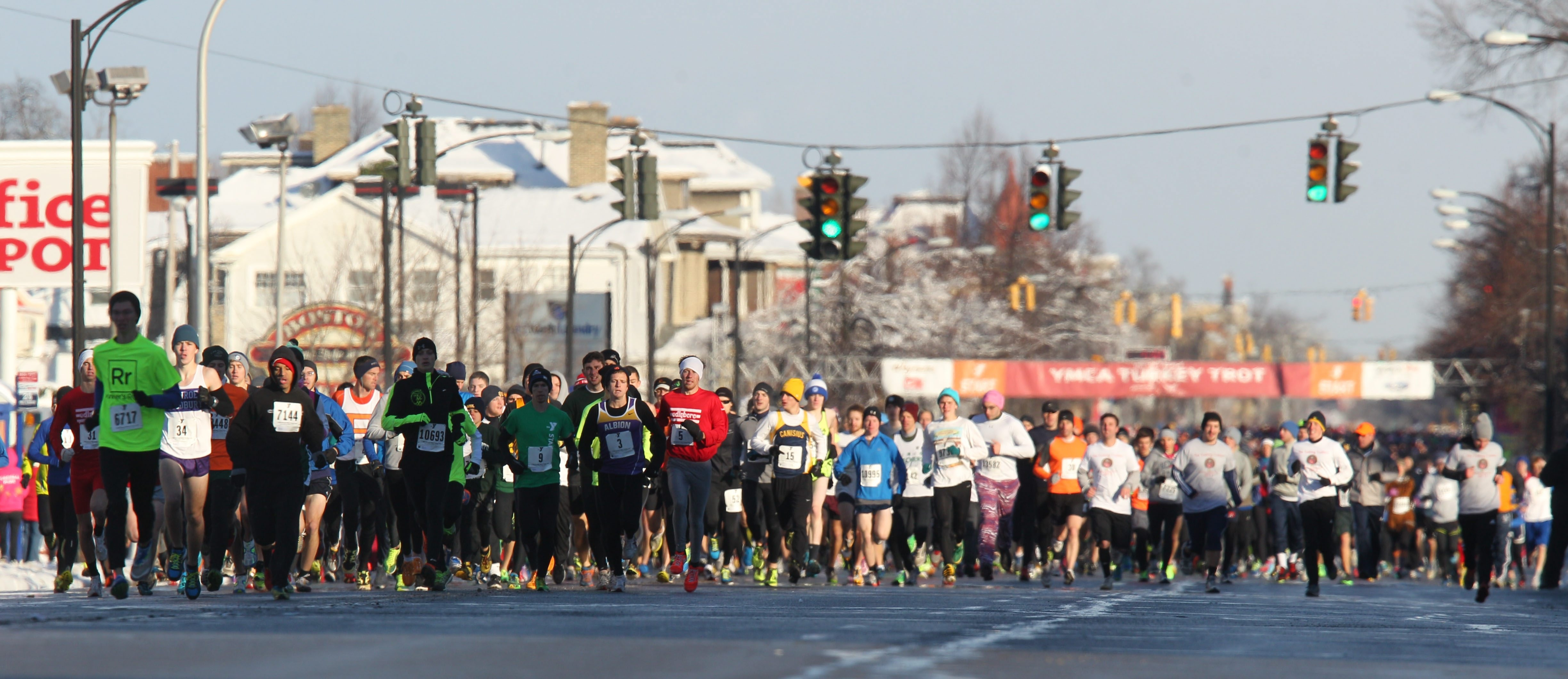 More then 14,000 runners participated in the 118th annual YMCA Turkey Trot 2013, last year.  This is the start of the race on Delaware Ave. near Hertel Ave. (Sharon Cantillon/Buffalo News)
