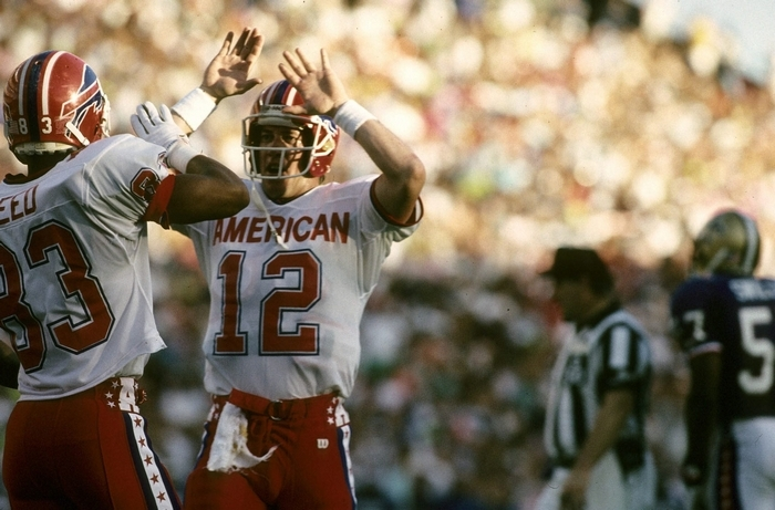 Bills teammates Andre Reed and Jim Kelly slap hands after connecting for a 20-yard TD in the 1991 Pro Bowl. Kelly and Reed formed one of the top tandems in NFL history. (Associated Press)