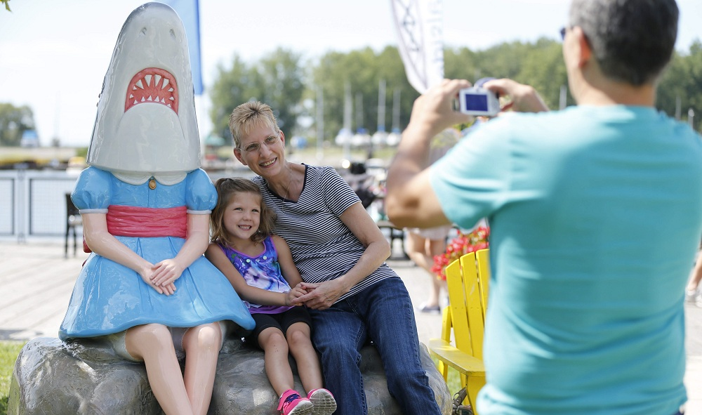 """""""Shark Girl"""" at Canalside has become a viral attraction since she was unveiled last week. (Derek Gee/Buffalo News)"""