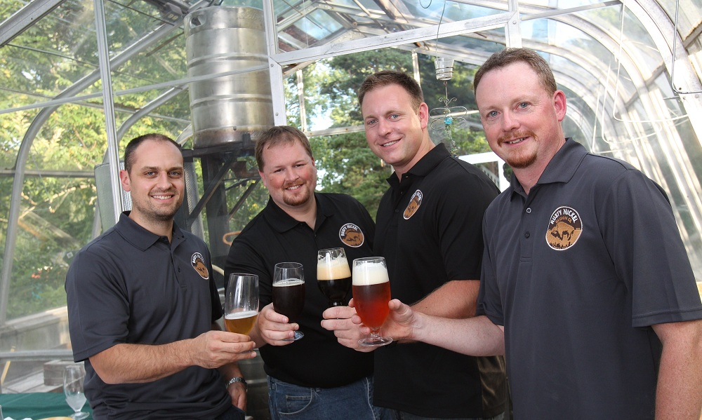 The owners of Rusty Nickel Brewing — Scott Fiege, Jim Ruppert, Jason Havens and Dave Johnson, left to right — will hold a tasting at KegWorks. (Sharon Cantillon / Buffalo News file photo)