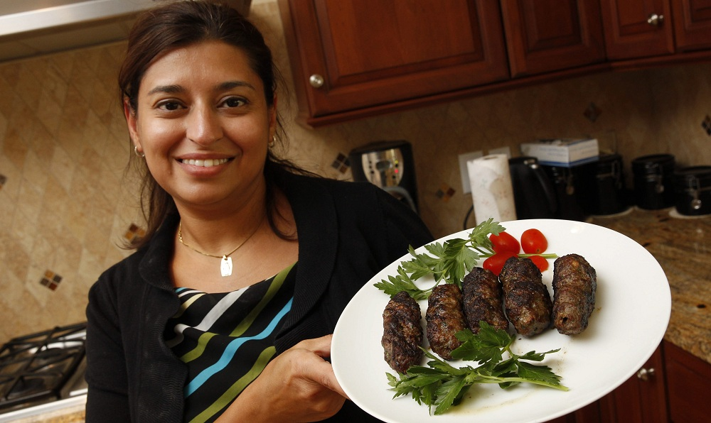 Jacklyn Iskander and a number of helpers prepared kofta, a traditional Egyptian food, for St. Mary and St. Moses Coptic Orthodox Church's upcoming festival. (Sharon Cantillon/Buffalo News)