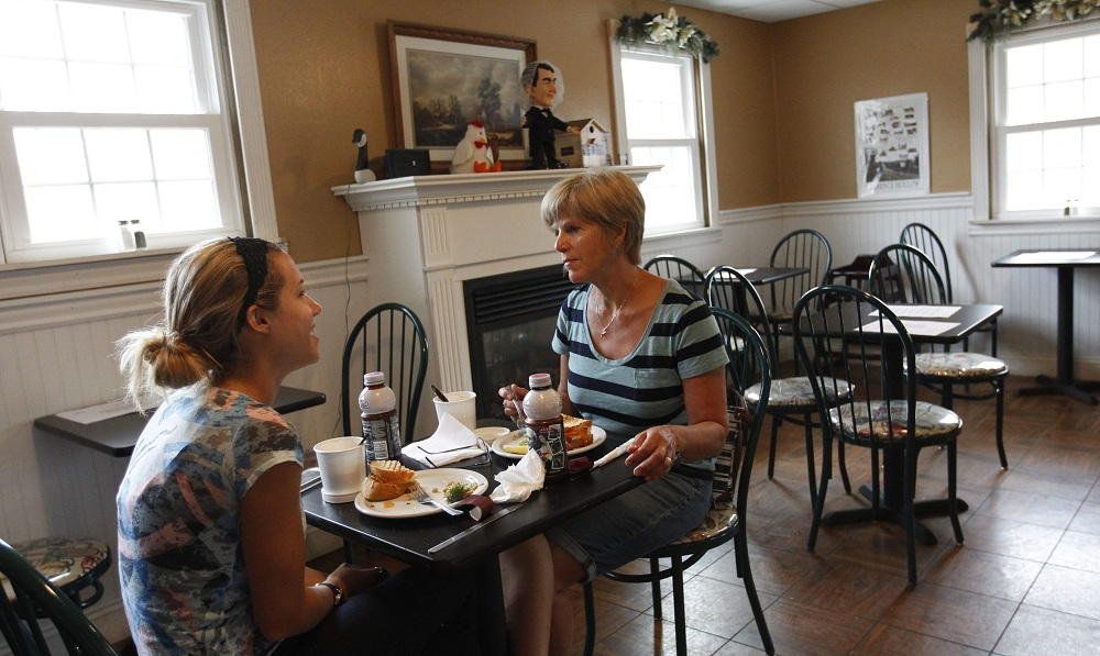 Brigit May, left, and her mother Claire, of Clarence, have lunch at McDuffies Bakery. (Sharon Cantillon / Buffalo News)