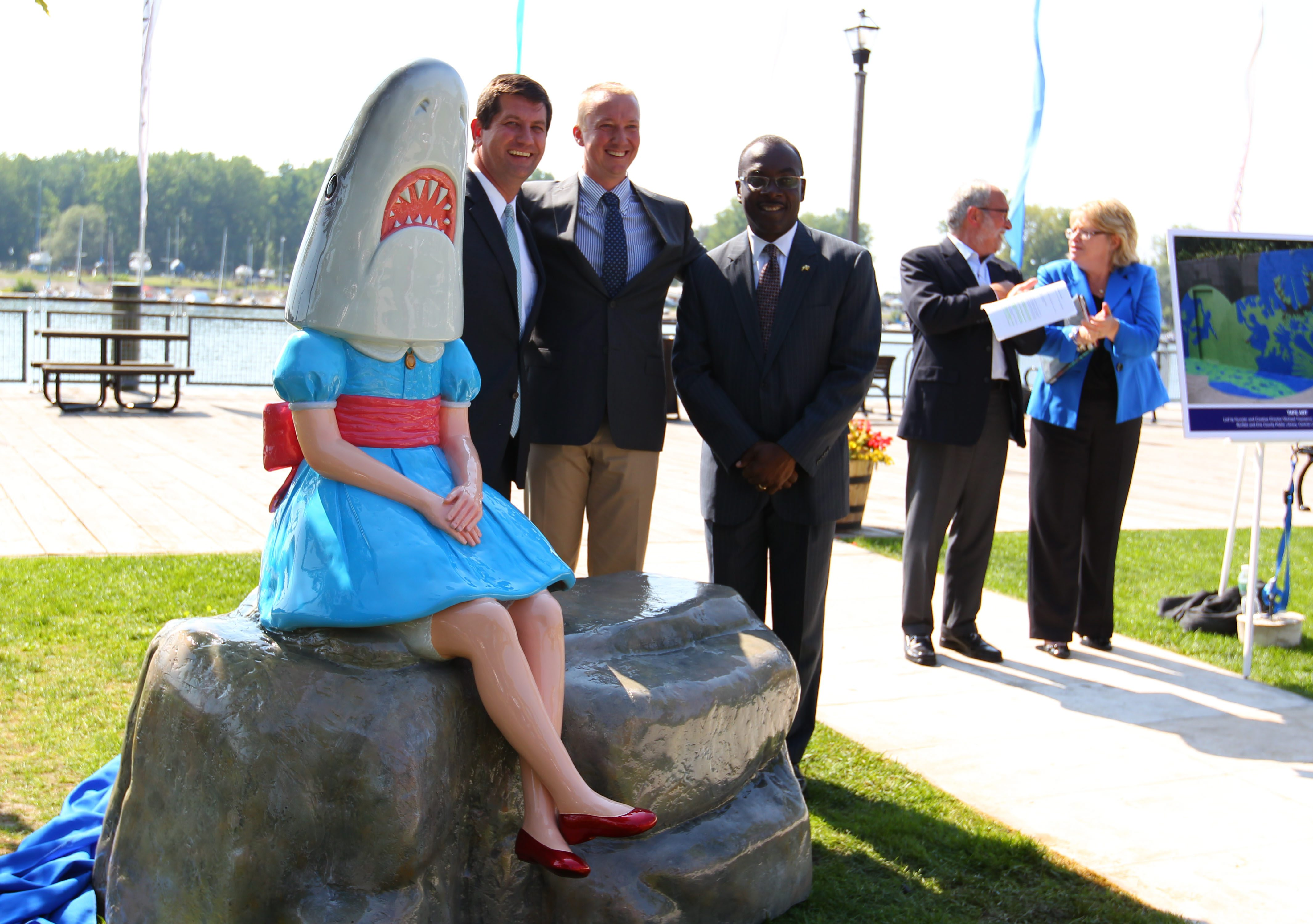 County Executive Mark Poloncarz, left, Albright Knox Executive Dir. Dr. Janne Siren, center, and Mayor Byron Brown, right, unviel a new sculpture during a ceremony at Canalside in Buffalo Tuesday, August 26, 2014.   (Mark Mulville/Buffalo News)